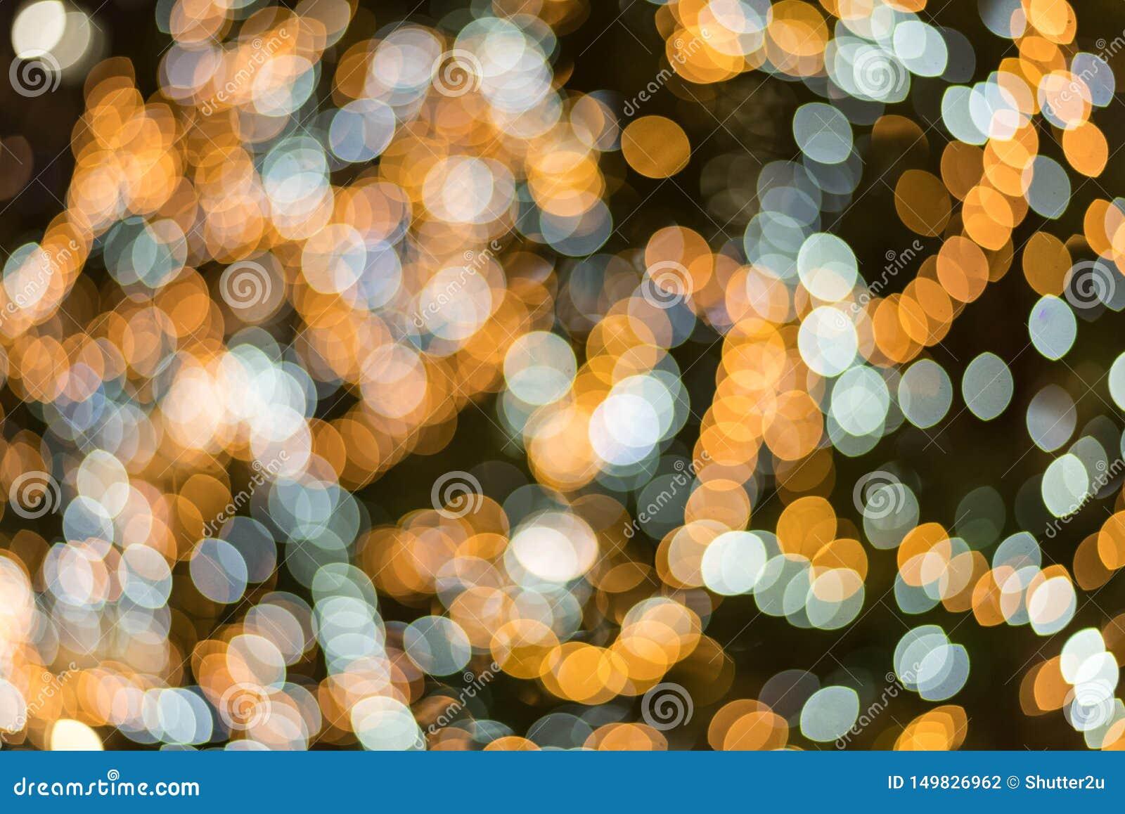 Bl? och gul abstrakt oskarp ljus bokehbakgrund f?r samkopiering ?rsdag- och ber?mbegrepp Festival för nytt år och