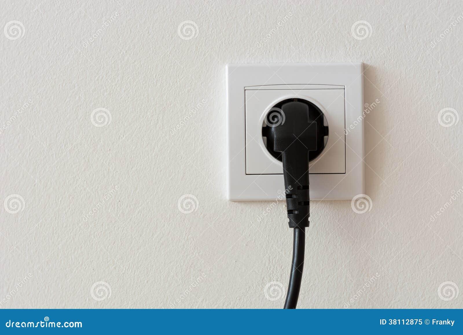 Black 220 Volt Power Plug Plugged In A Socket