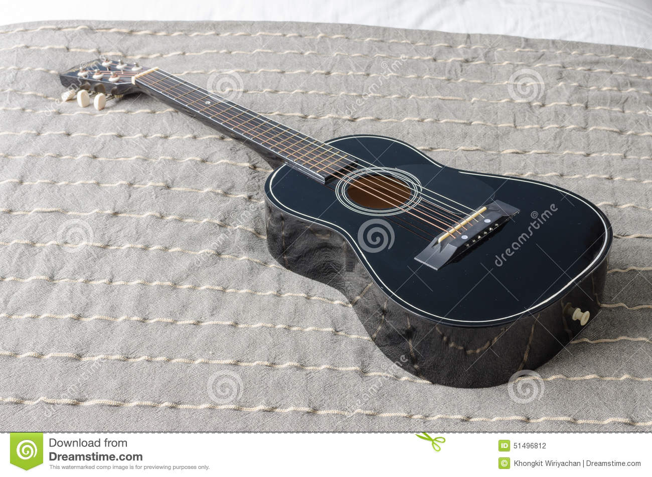 Black Acoustic Guitar On Bed Stock Photo Image Of Modern Classic