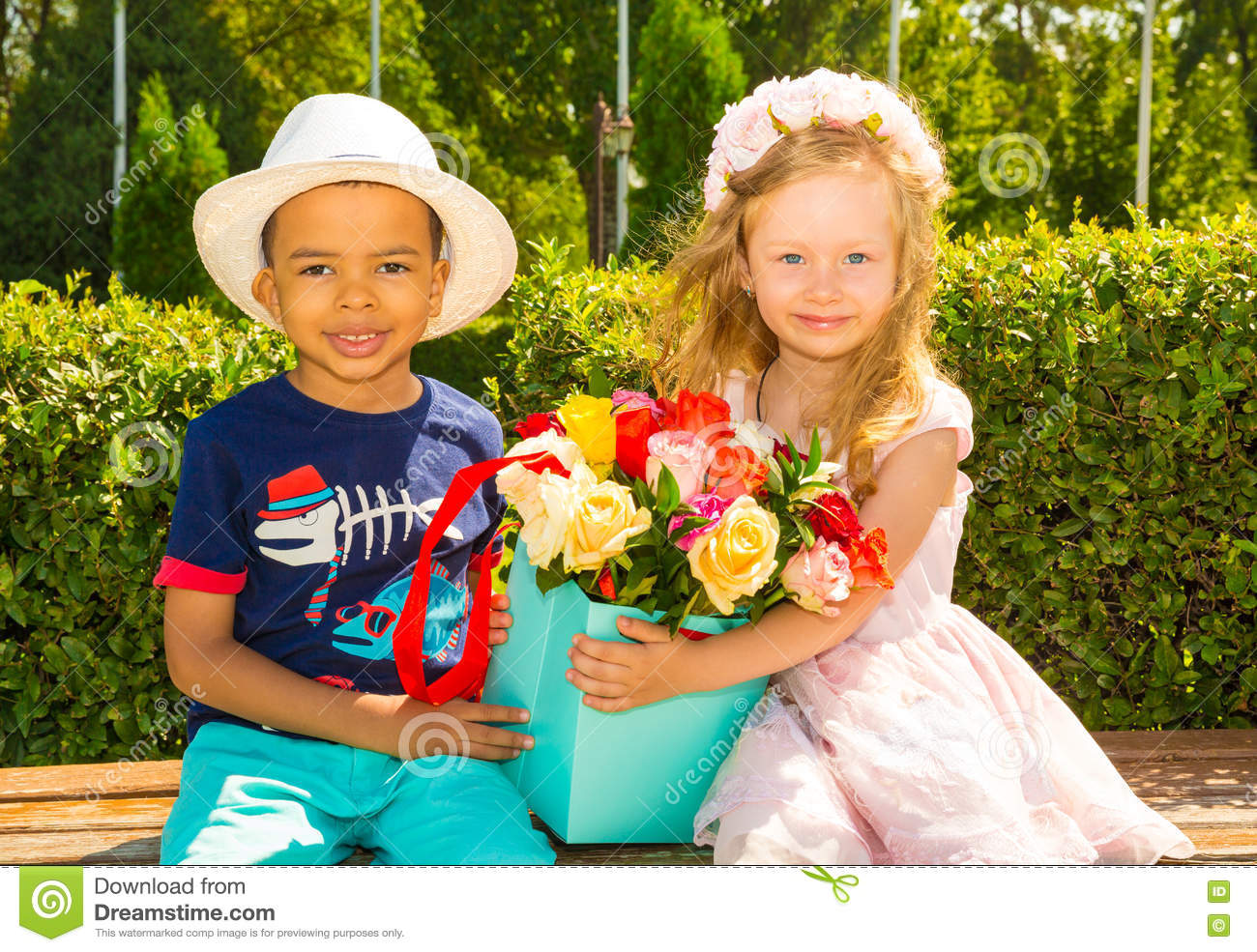 Black African American Boy Kid Gives Flowers To Girl Child On Birthday Little Adorable Children In Park