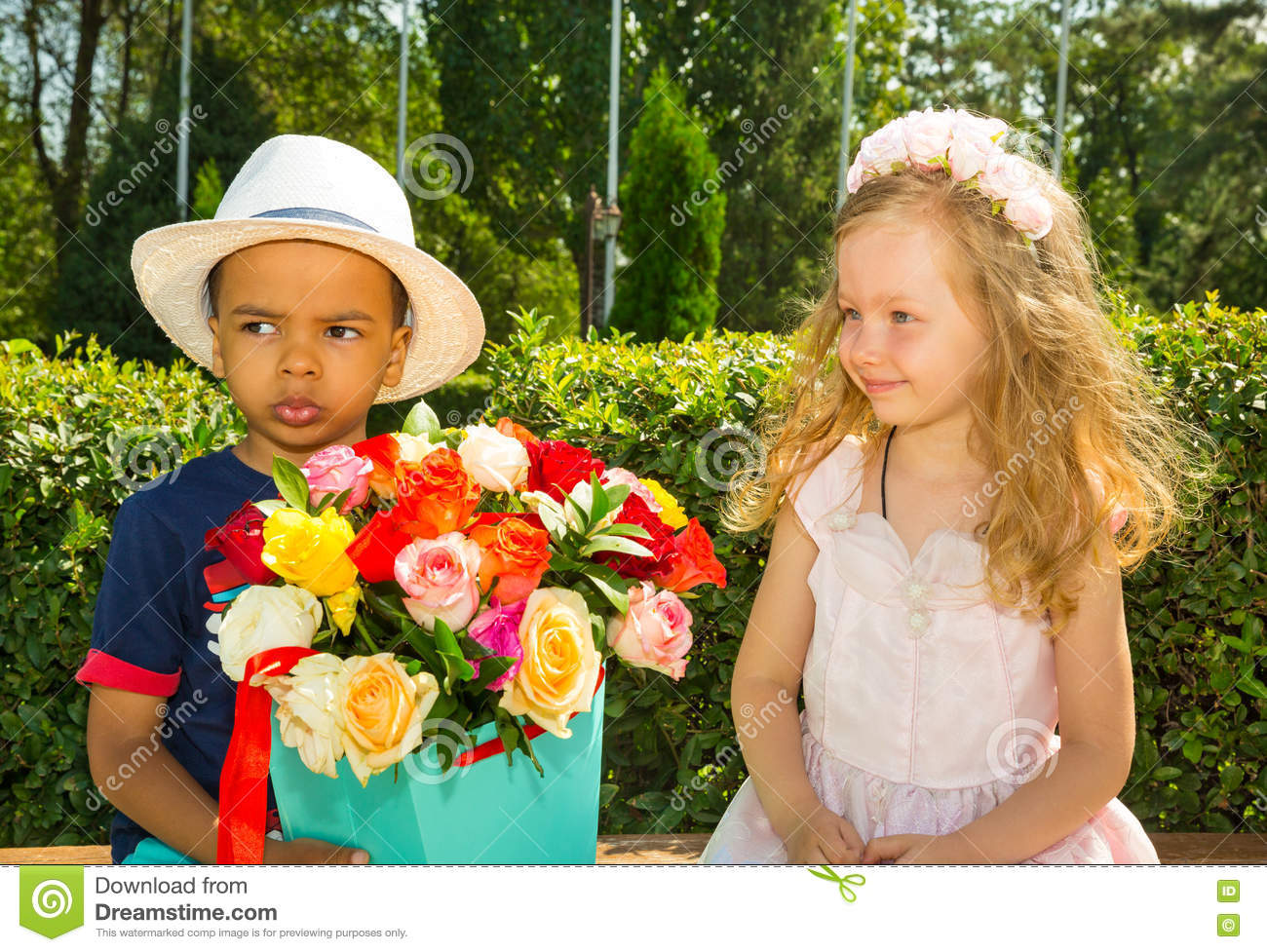 Black African American Boy Kid Gives Flowers To Girl Child On Birthday Little Adorable Children