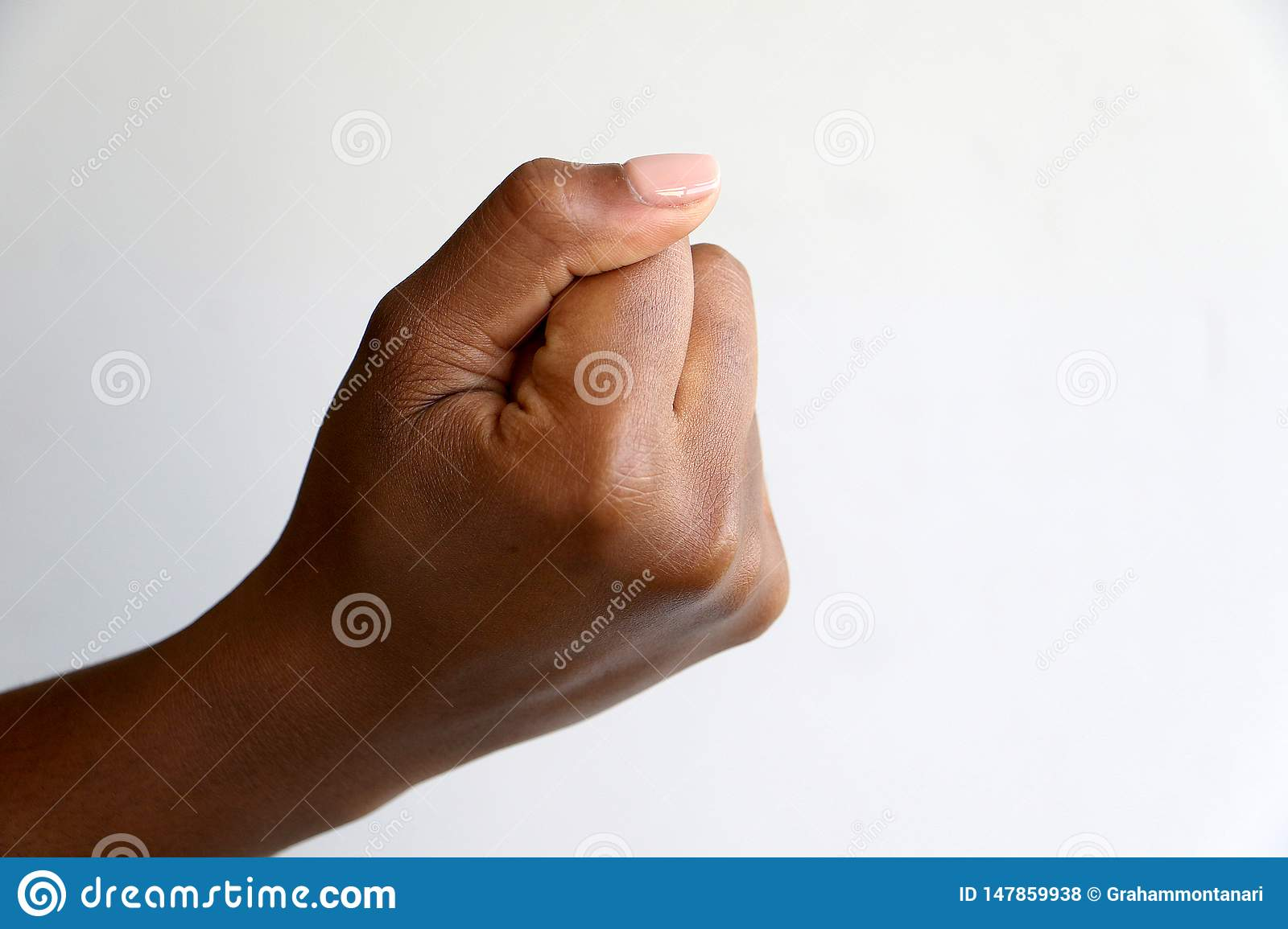 Black African indian hand giving thumbs up