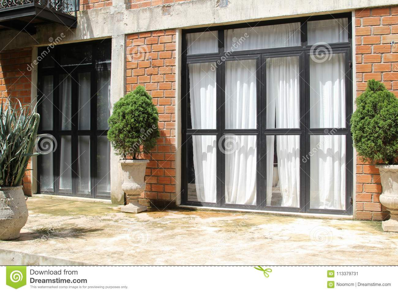 Door With Glass Frame On Brick Wall Stock Image - Image of