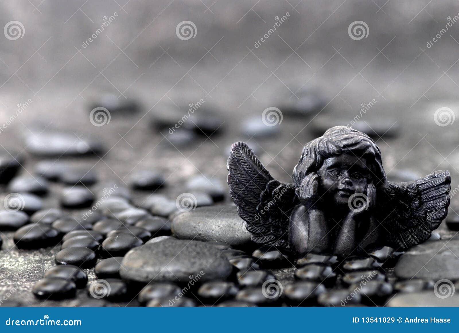 Black angel and stone