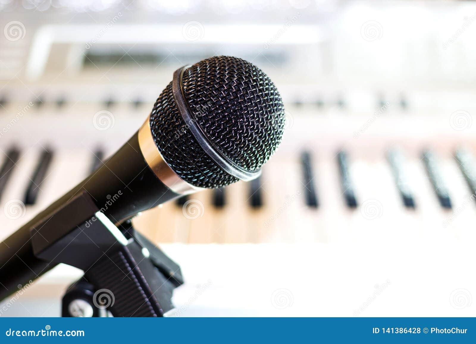 Black audio microphone on rack closeup