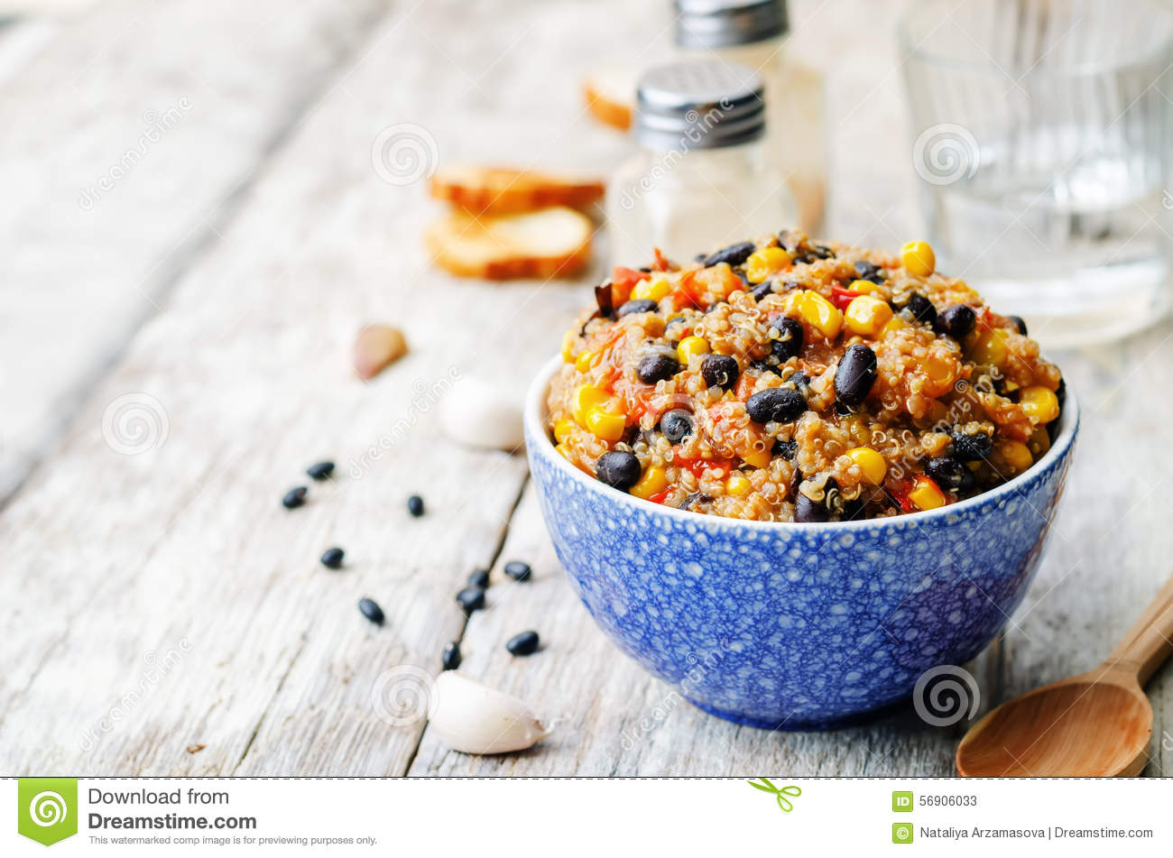 Black beans, quinoa and corn chili on a white wood background. the ...