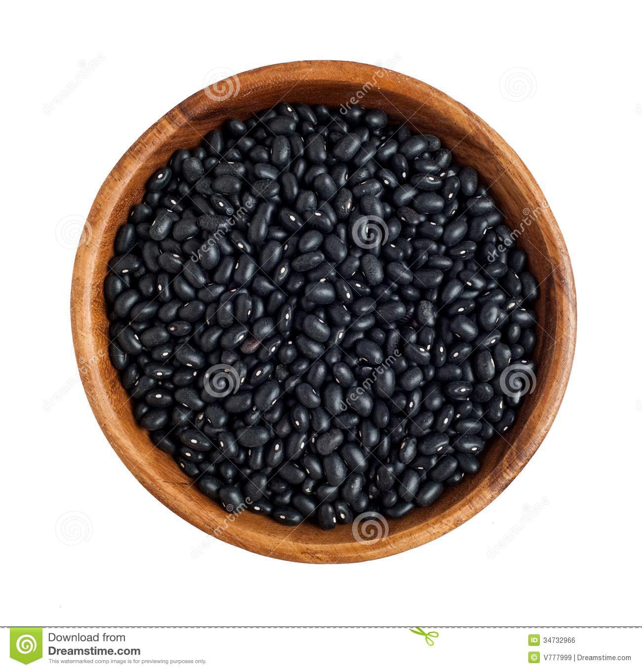 Top view of wooden bowl full of black beans.