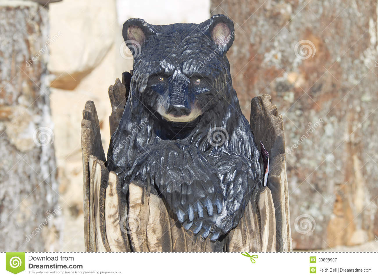 Black Bear Cub Peaking Out Of Stump Wood Carving Royalty Free Stock ...