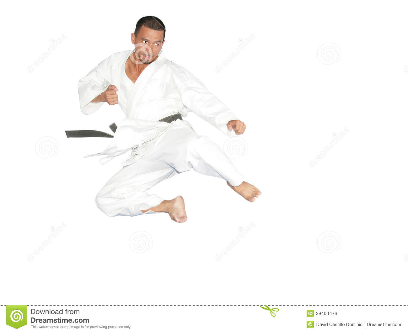 Black Belt Karate Man Jumping To Give A High Kick Stock