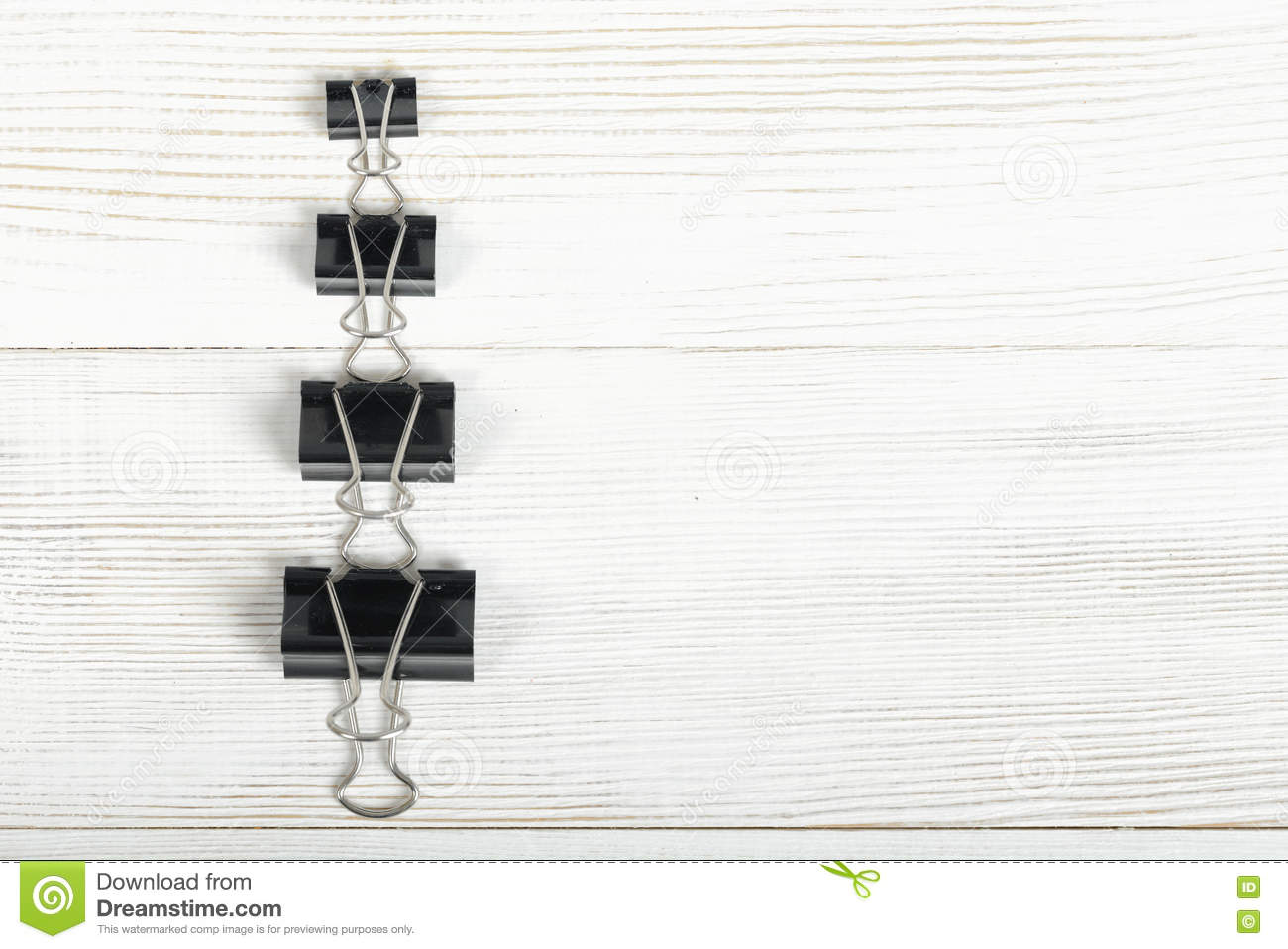 black binder clips posted from the biggest to smallest on a wooden