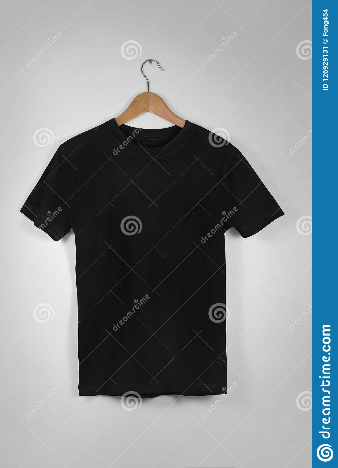 Black Blank Cotton Tshirt Hanging Center Gray Concrete Empty Wall Background with clipping path