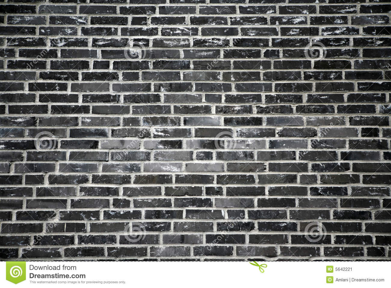 black brick wall   it looks almost like a black and white photograph