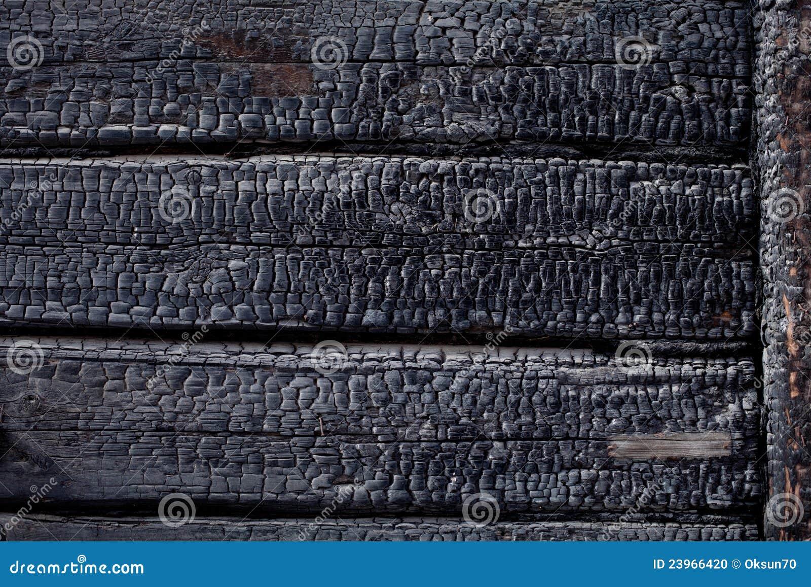 Black burned charred burnt wood background texture