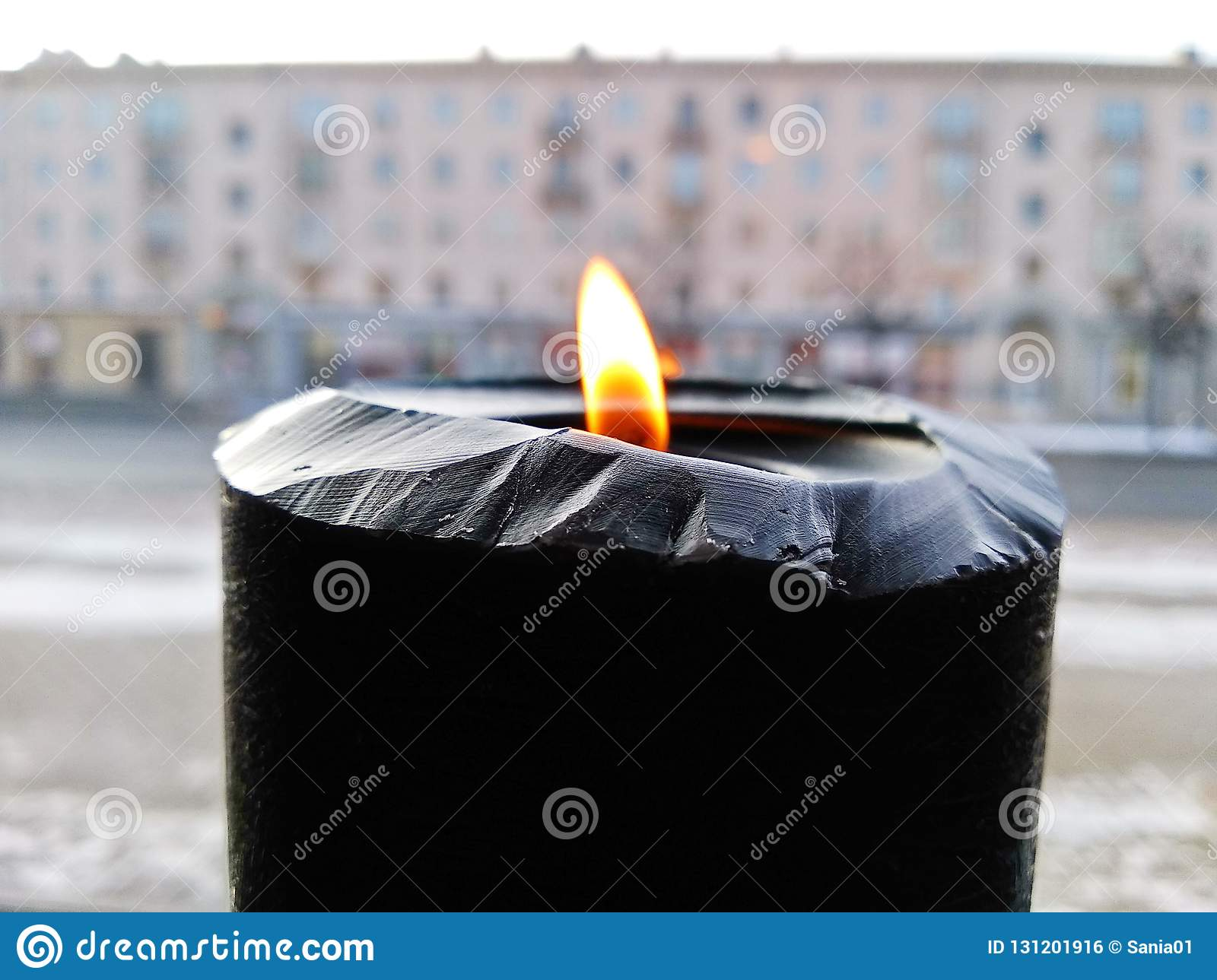 Black Burning Candle On City Background Outdoor. Stock ...