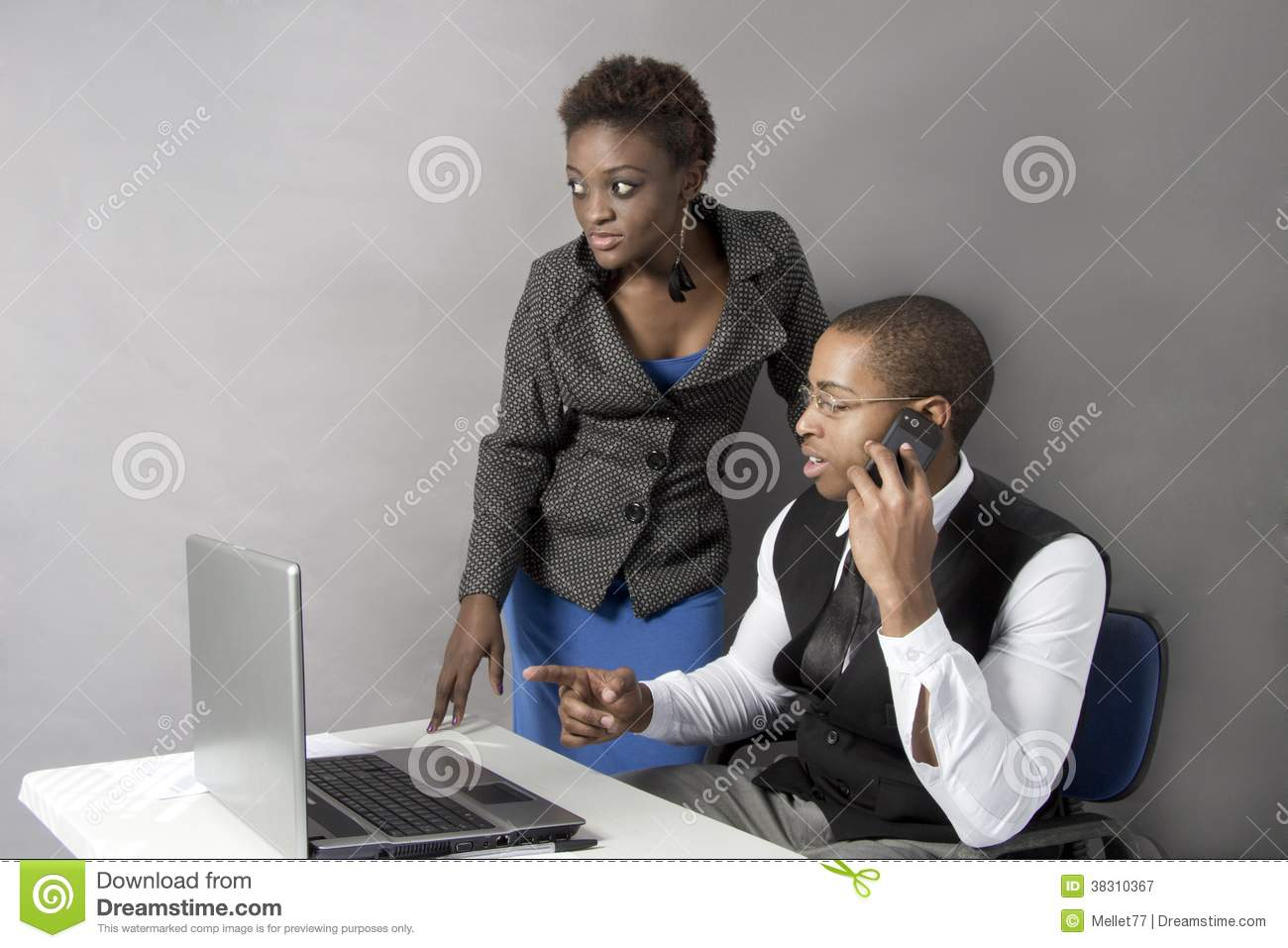 Black Business couple in office shaking hands.