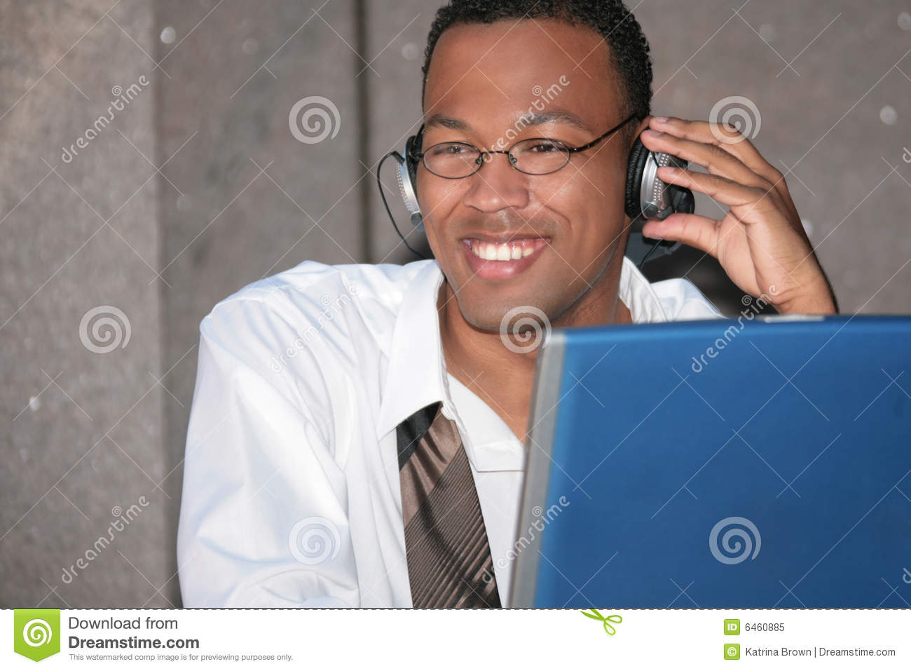 Black Business Man Listening To Music On His Laptop ...