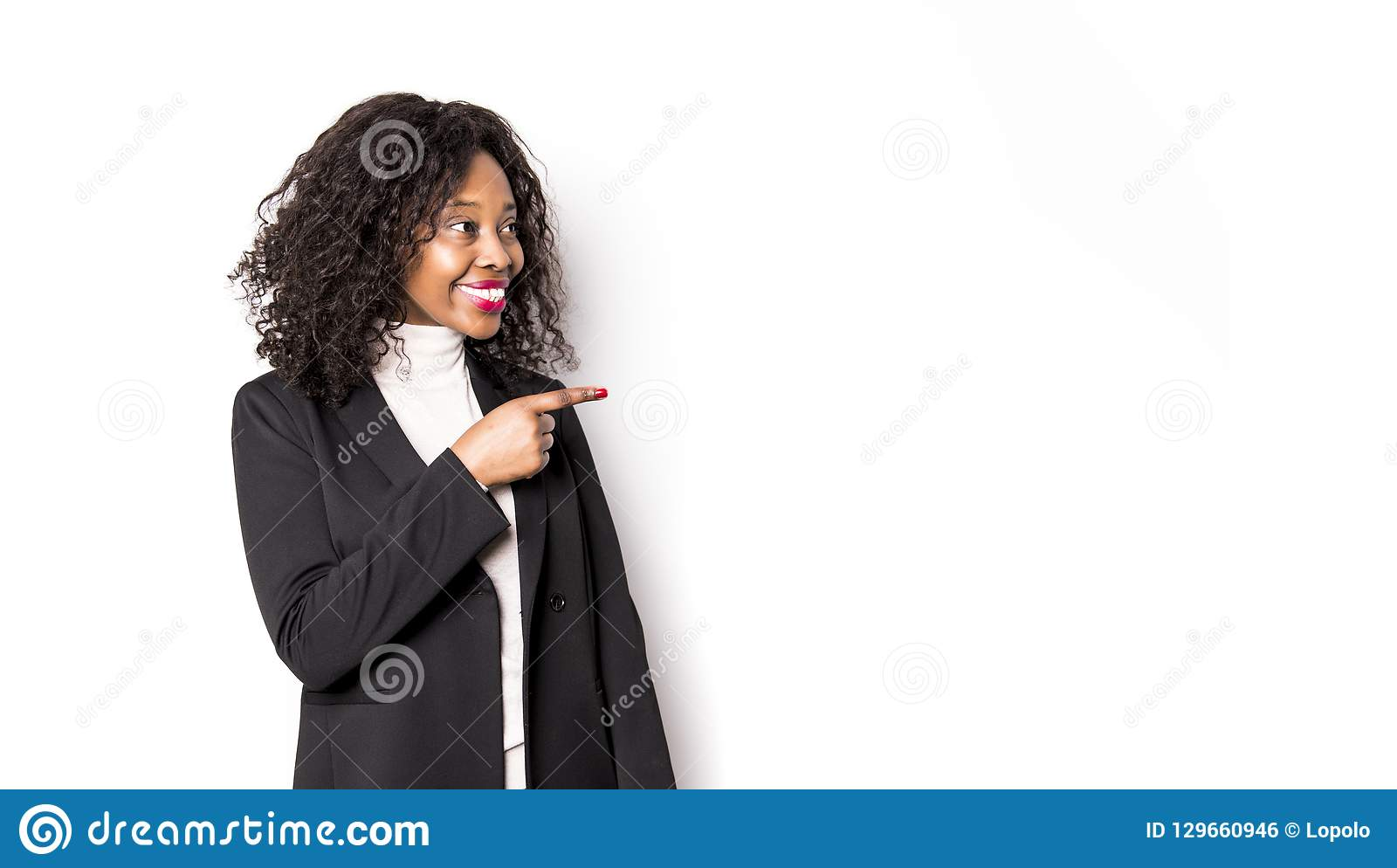 A black business woman poses for a portrait on studio white