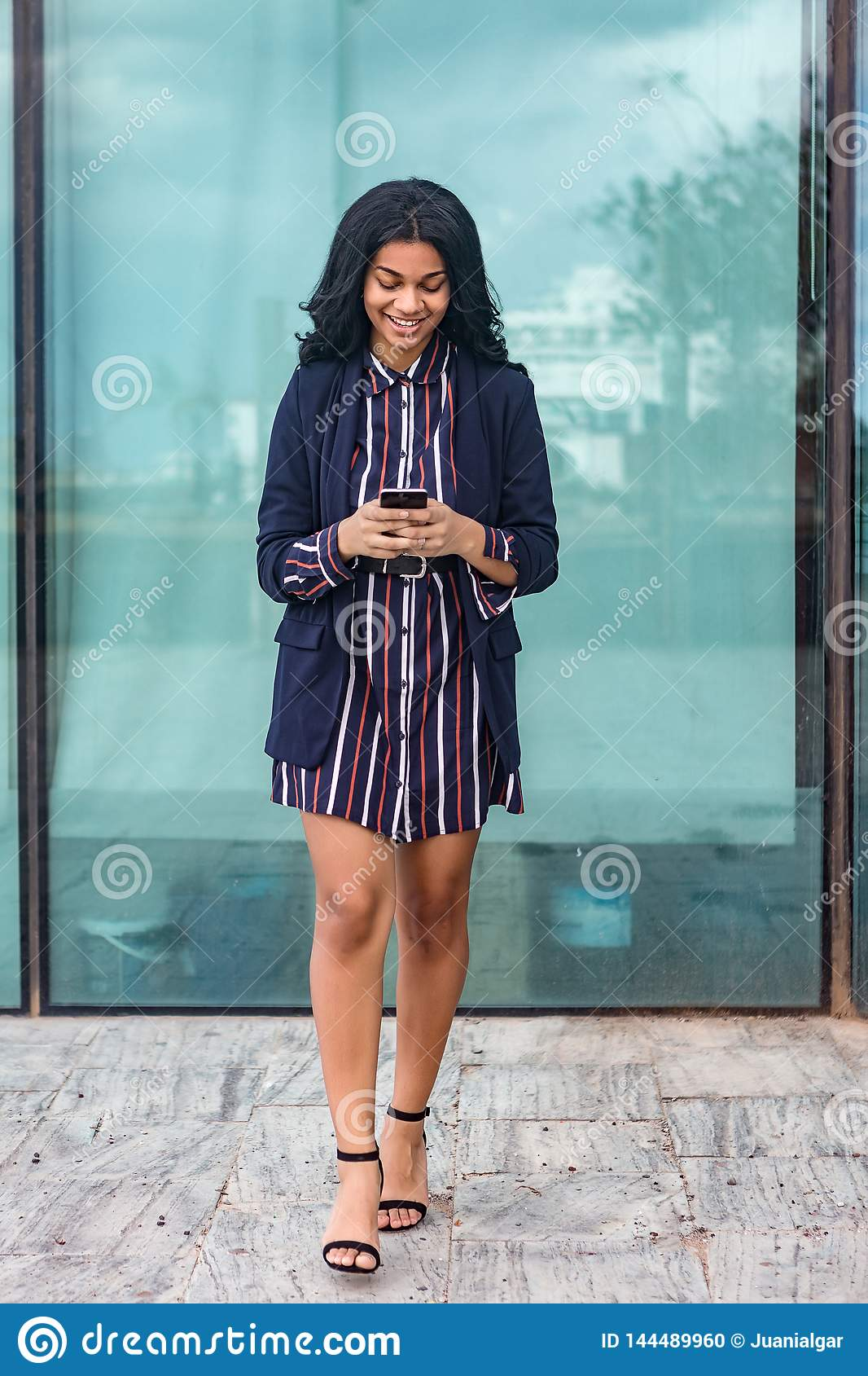 Black business woman with smart phone