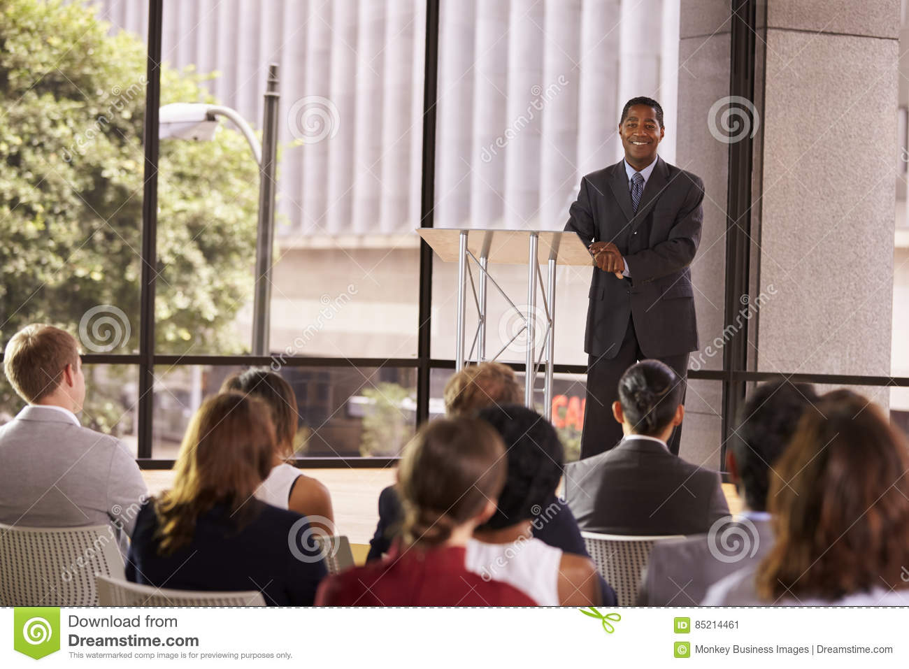 Download Black Businessman Presenting Seminar Smiling To Audience Stock Image - Image of ethnicity, business: 85214461