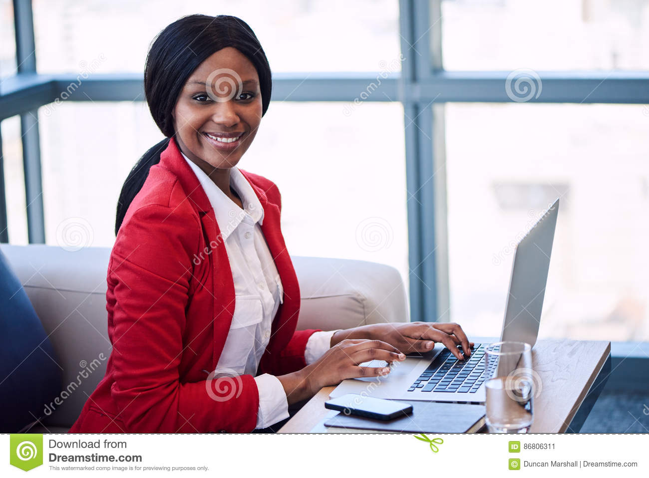 Download Black Businesswoman Smiling At The Camera While Seated On Sofa Stock Image - Image of dedicated, committed: 86806311