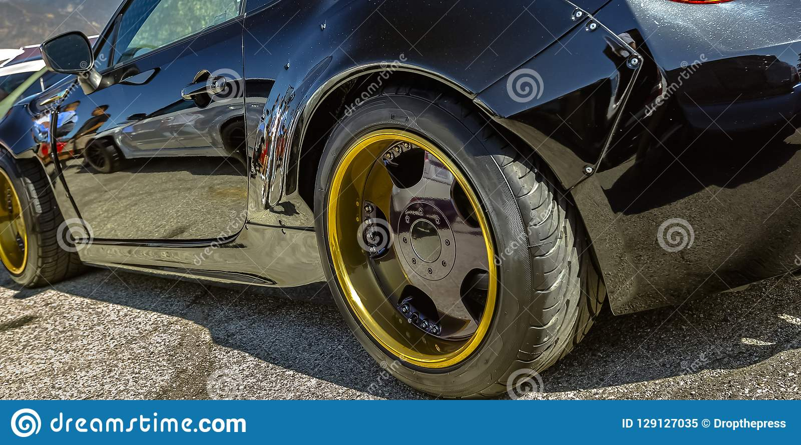 Black Car With Gold Wheel Rim And Black Spokes Stock Image Image