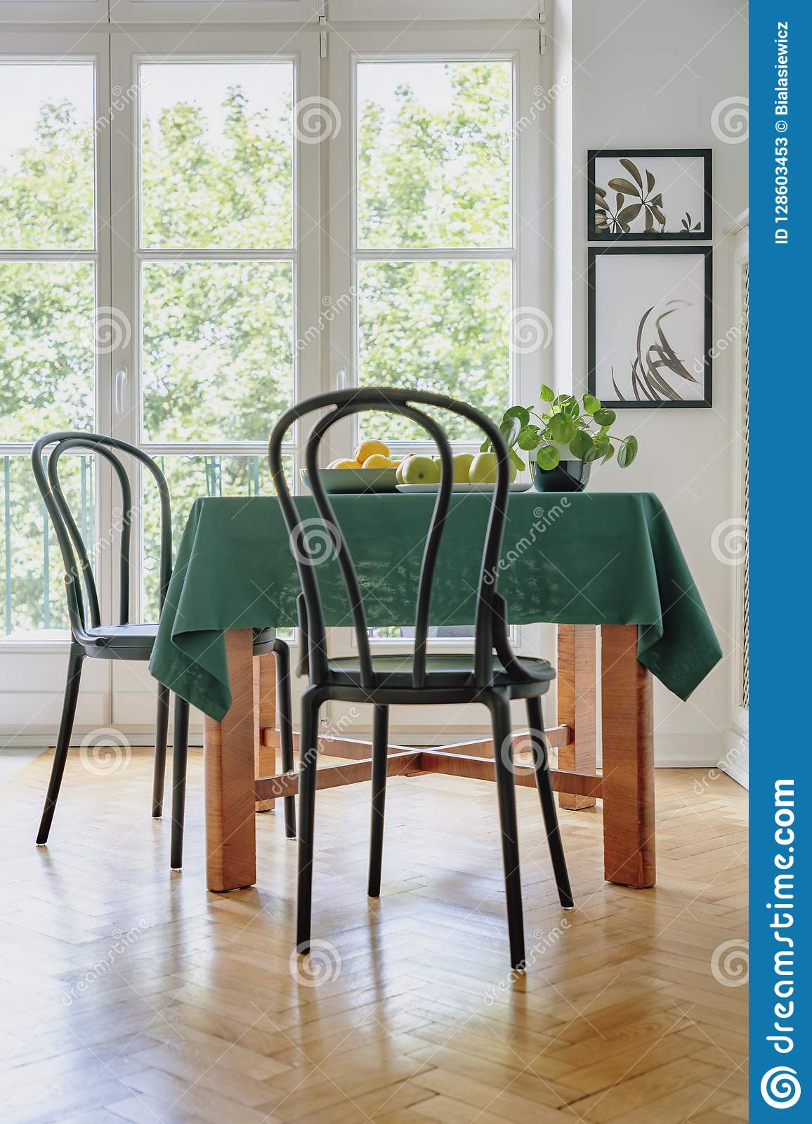Black Chair Next To A Table With Green Cloth In A Dining ...