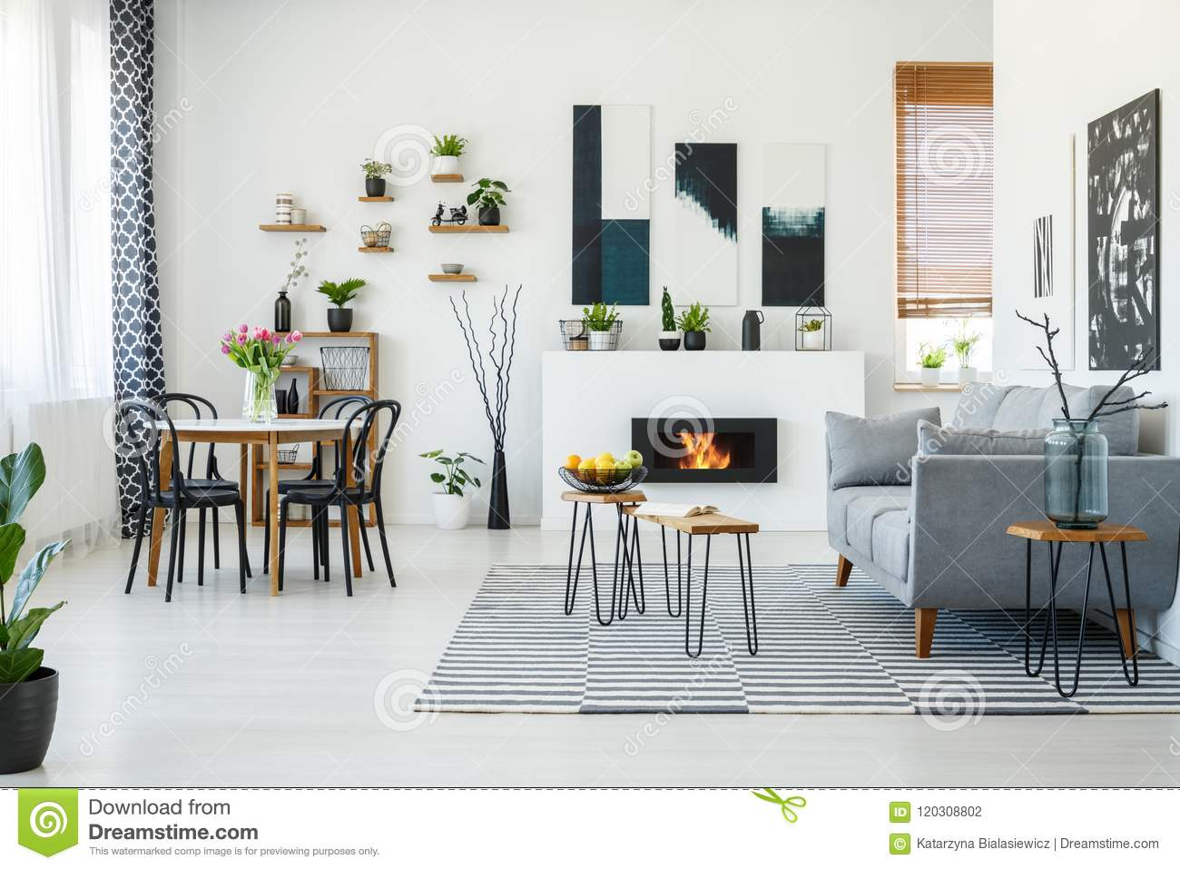 Black Chairs At Dining Table In Bright Living Room Interior With Grey Sofa Near Fireplace Real Photo