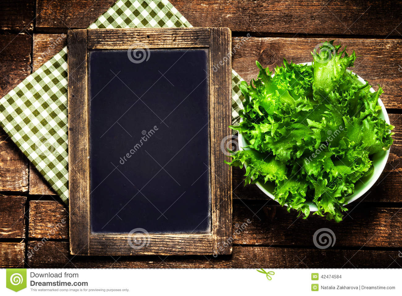 Black Chalkboard For Menu And Fresh Salad Over Wooden Background Stock ...