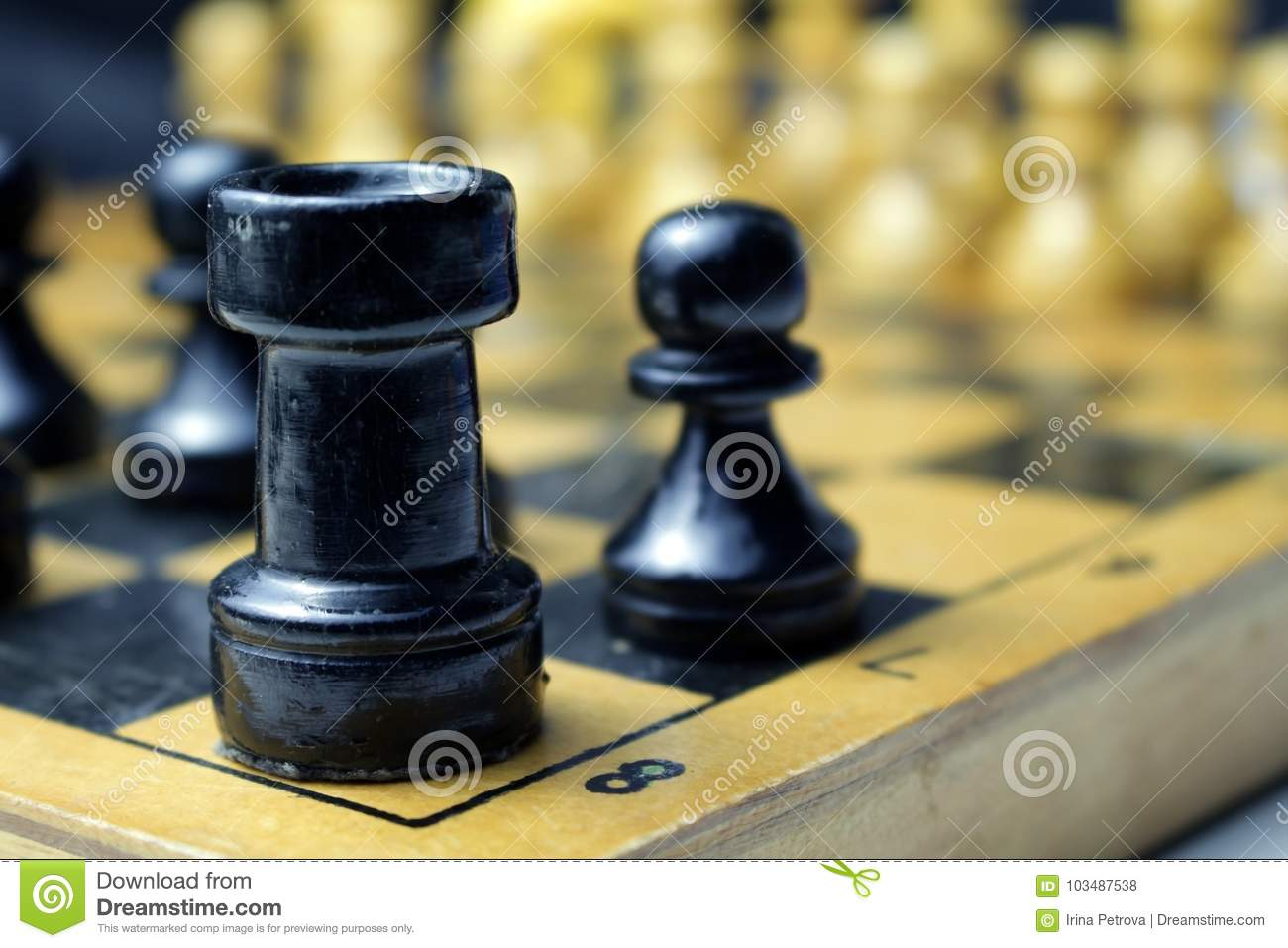 Black Chess Pieces The Rook And The Pawn On The Board Stock