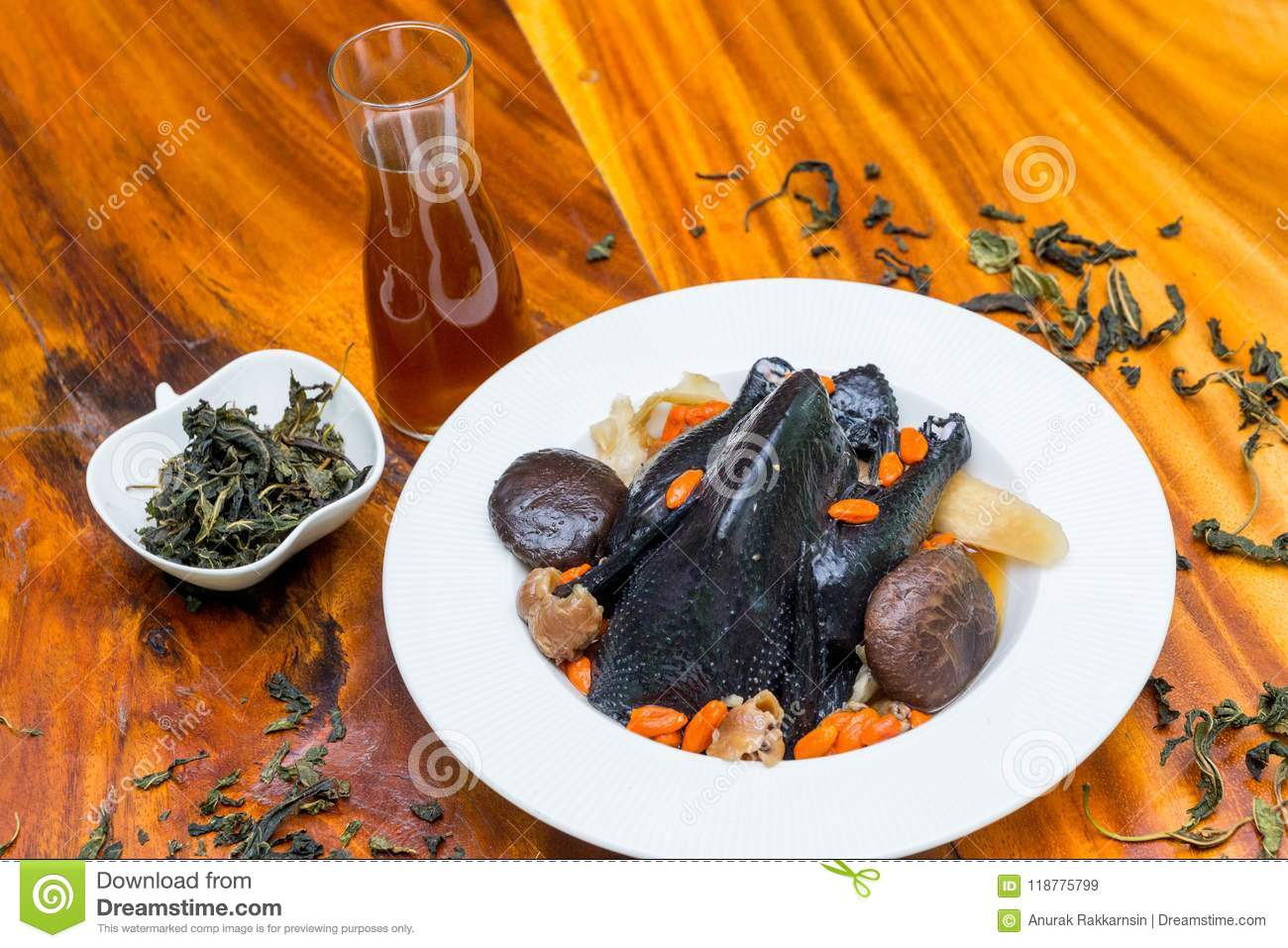Black chicken Soup on wood dish