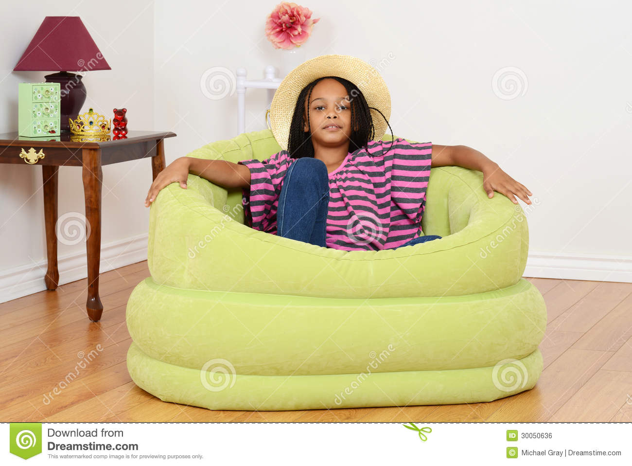Black Child Relaxing In Green Chair Stock Photo Image 30050636