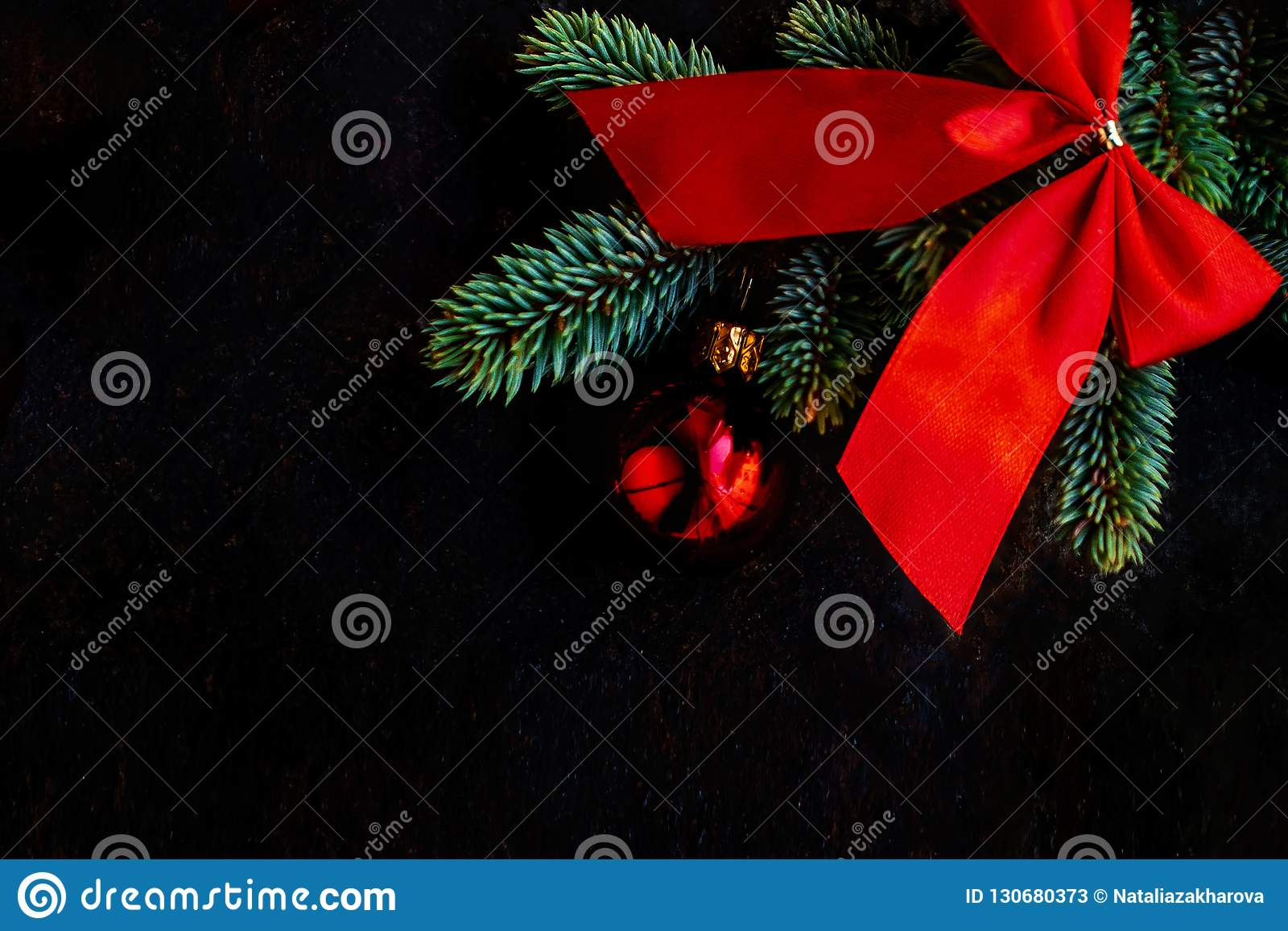 Black Christmas Background With Fir Tree Branch And Red Decorat
