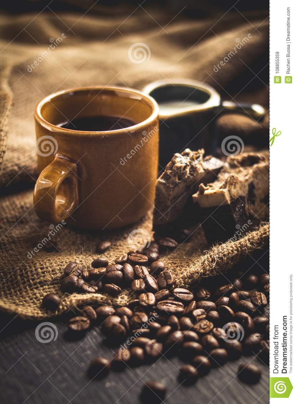 Black coffee Arabica In brown glass And milk and dessert Sack background in low light area