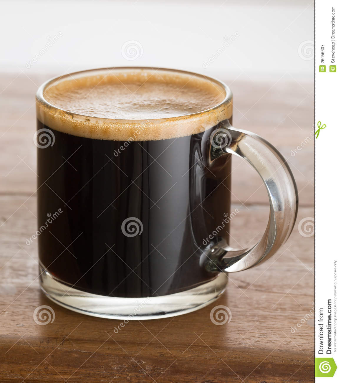 Black Coffee And Froth In Glass Mug Wood Table Stock Image