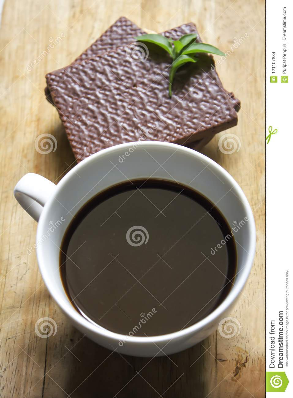 Black coffee in white glass and Wafer chocolate