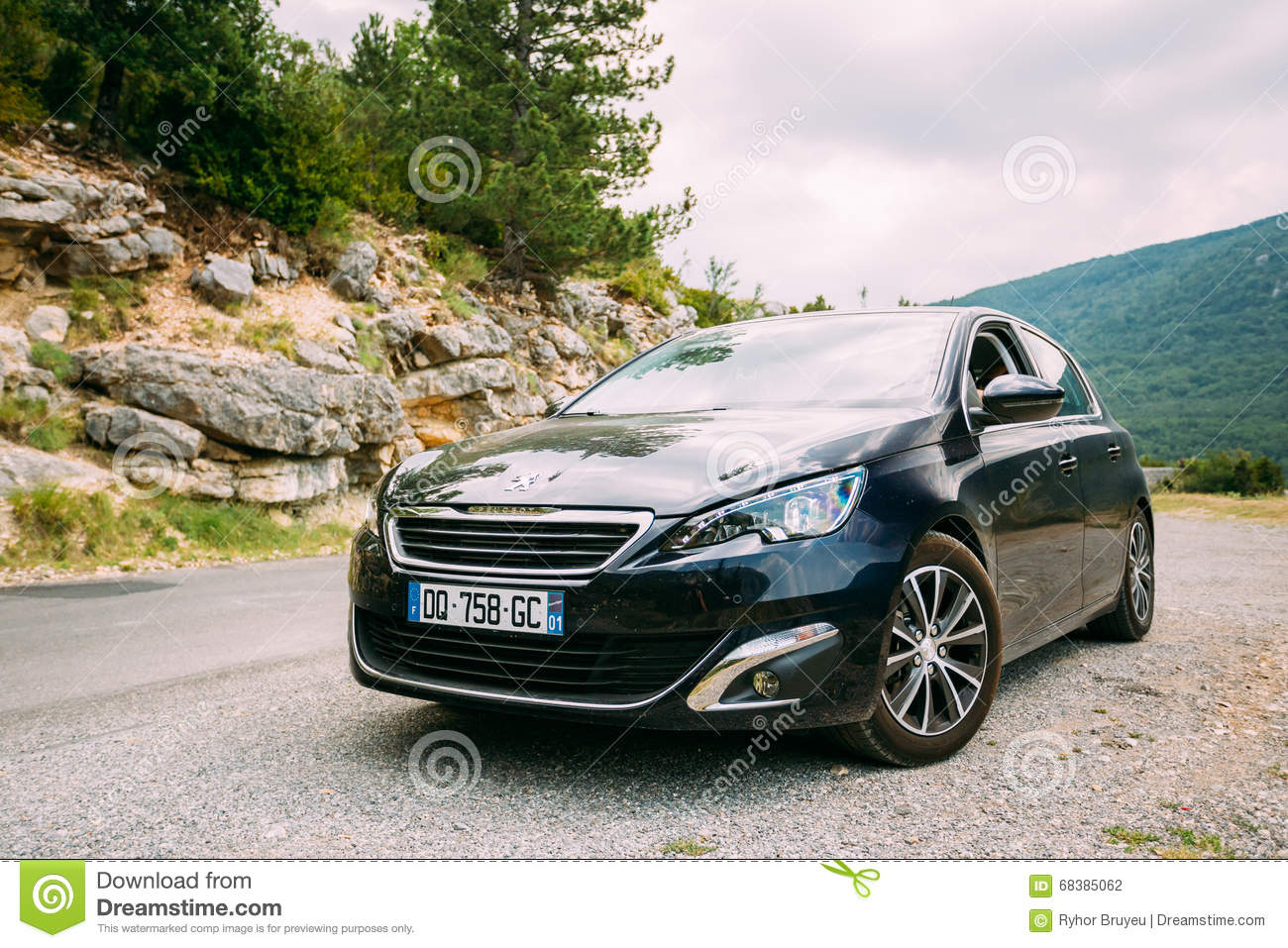 Black colour Peugeot 308 car on background of French mountain
