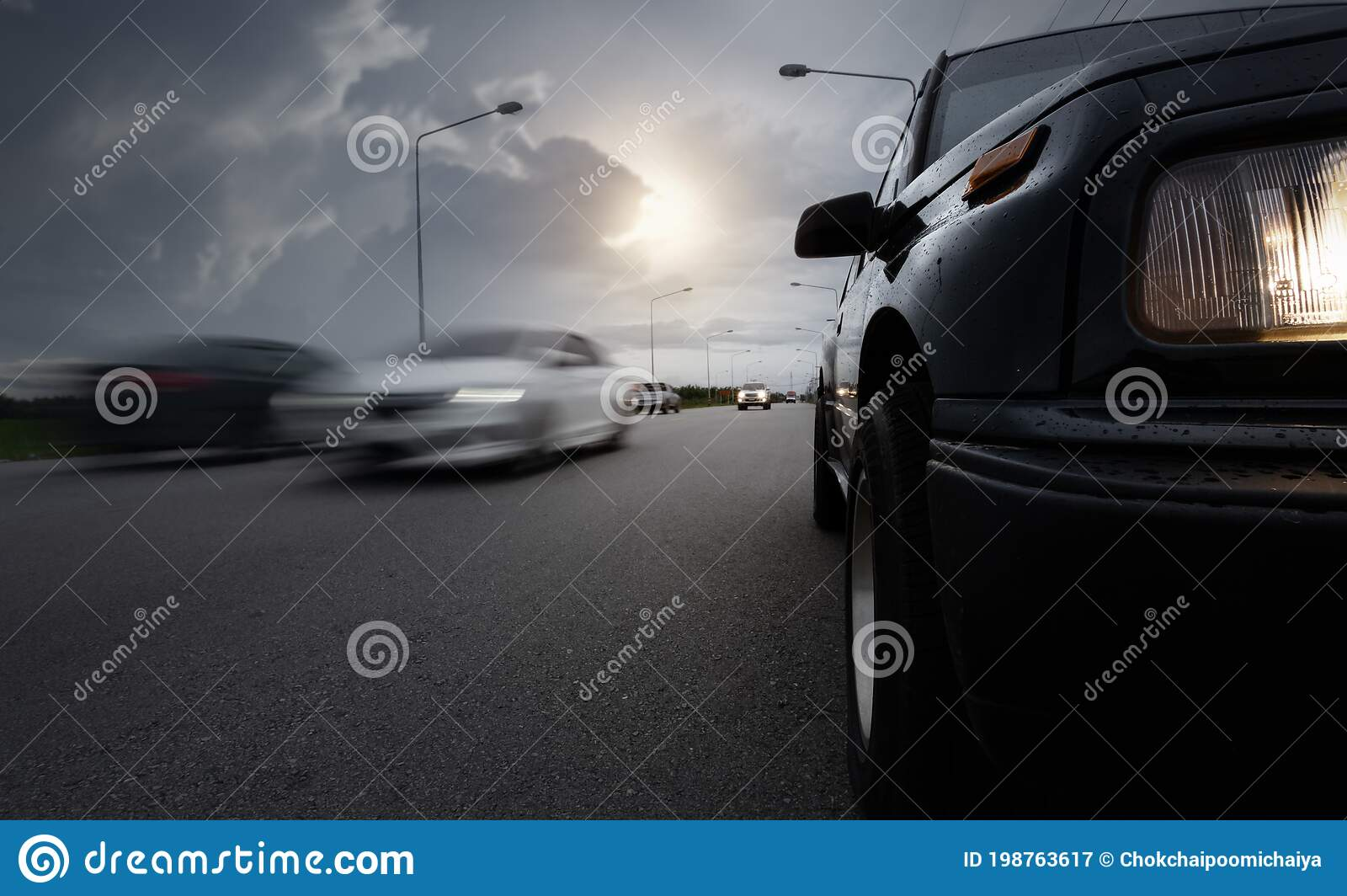 Black Compact Suv Car Stop On Wet Road With Speed Blurry Cars And Storm Clouds As Background Stock Image Image Of Depression Cloudscape 198763617