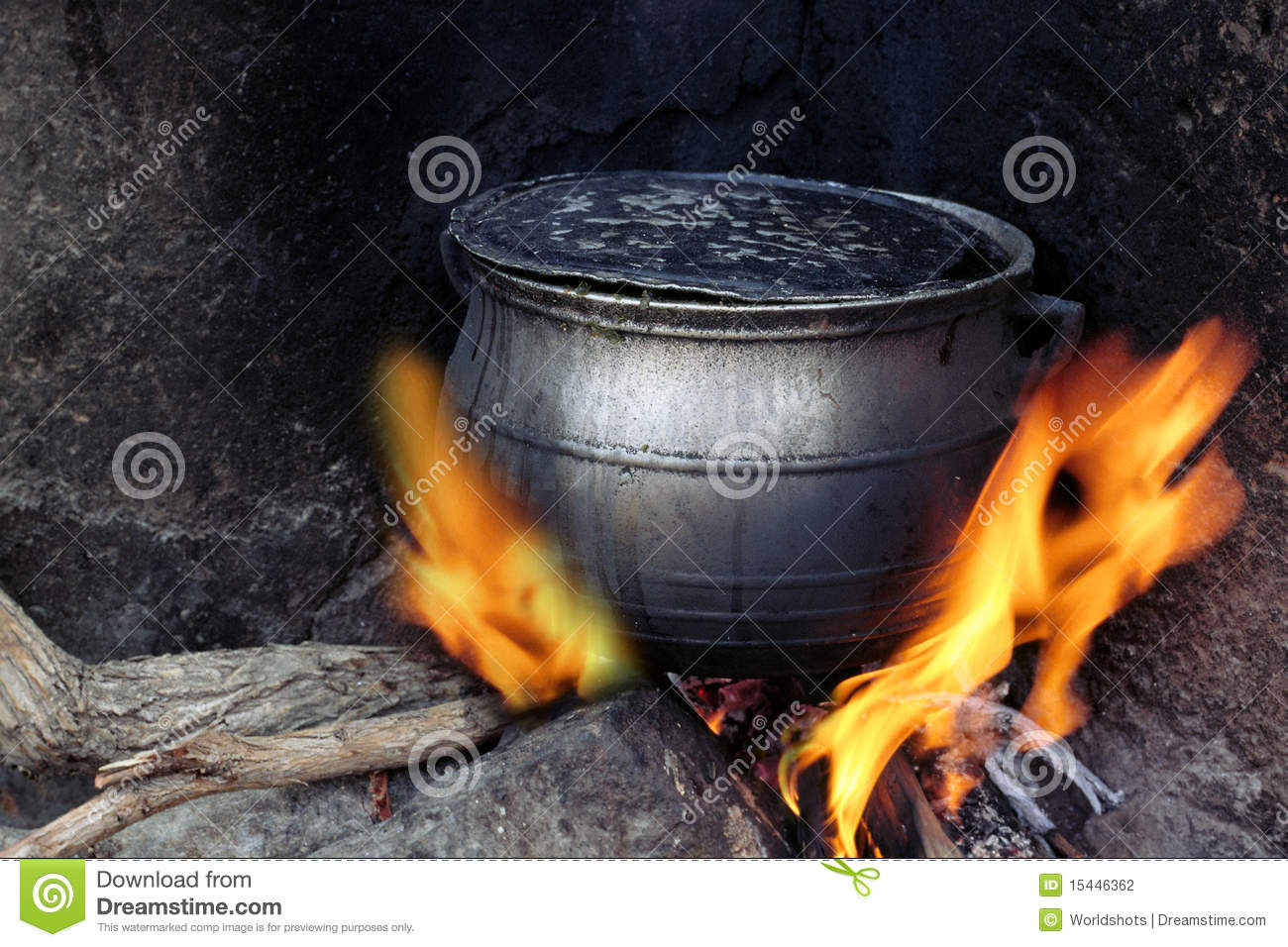 Black Coocking Pot Heated On Fire Stock Photography