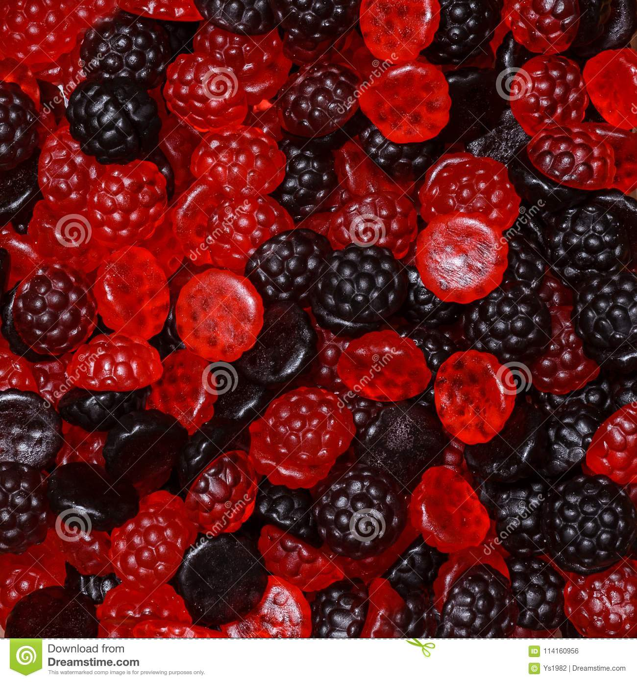 Black and cranberry candies in the form of raspberries and blackberries