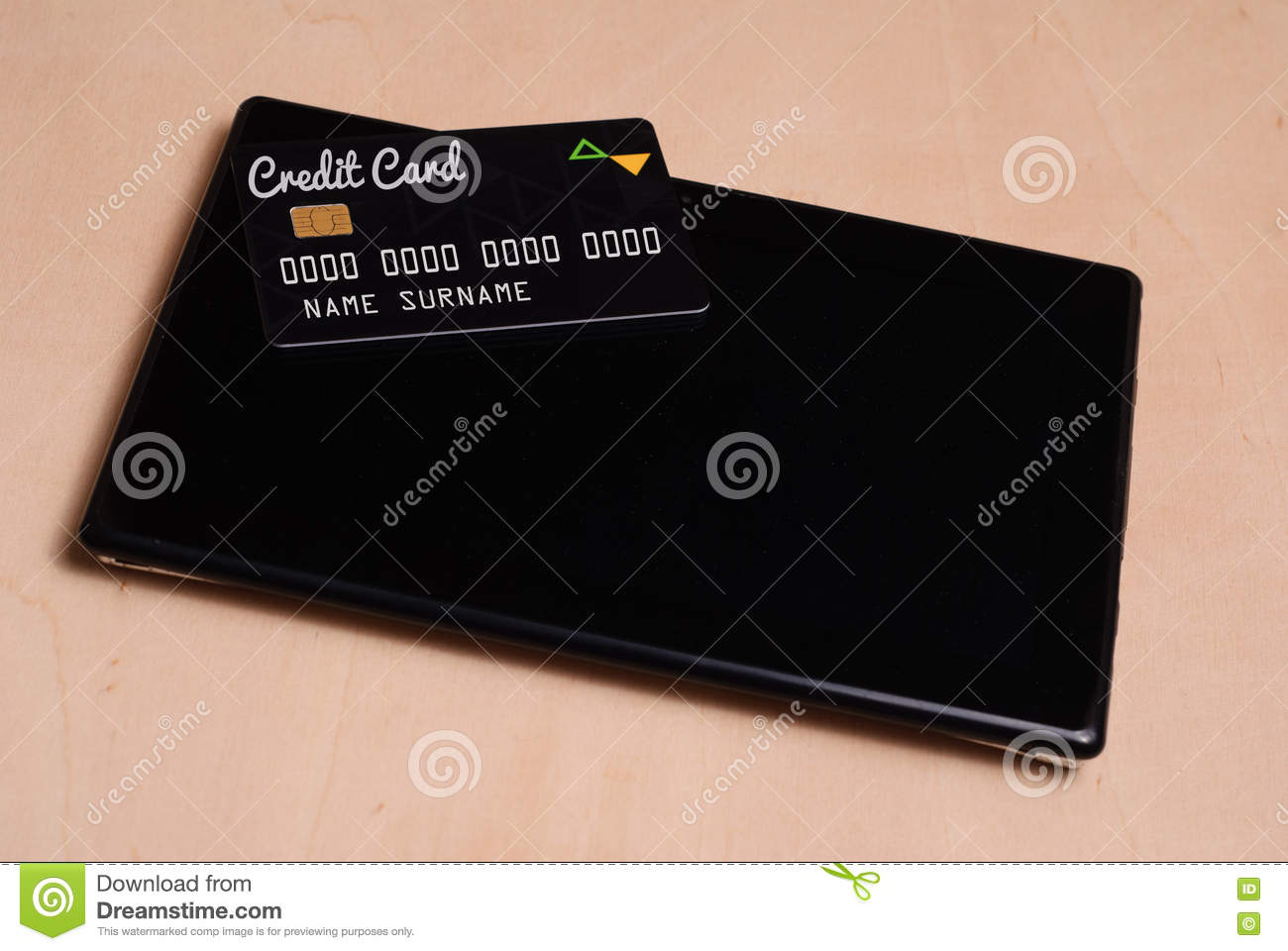 Black credit card is on a black electronic tablet,