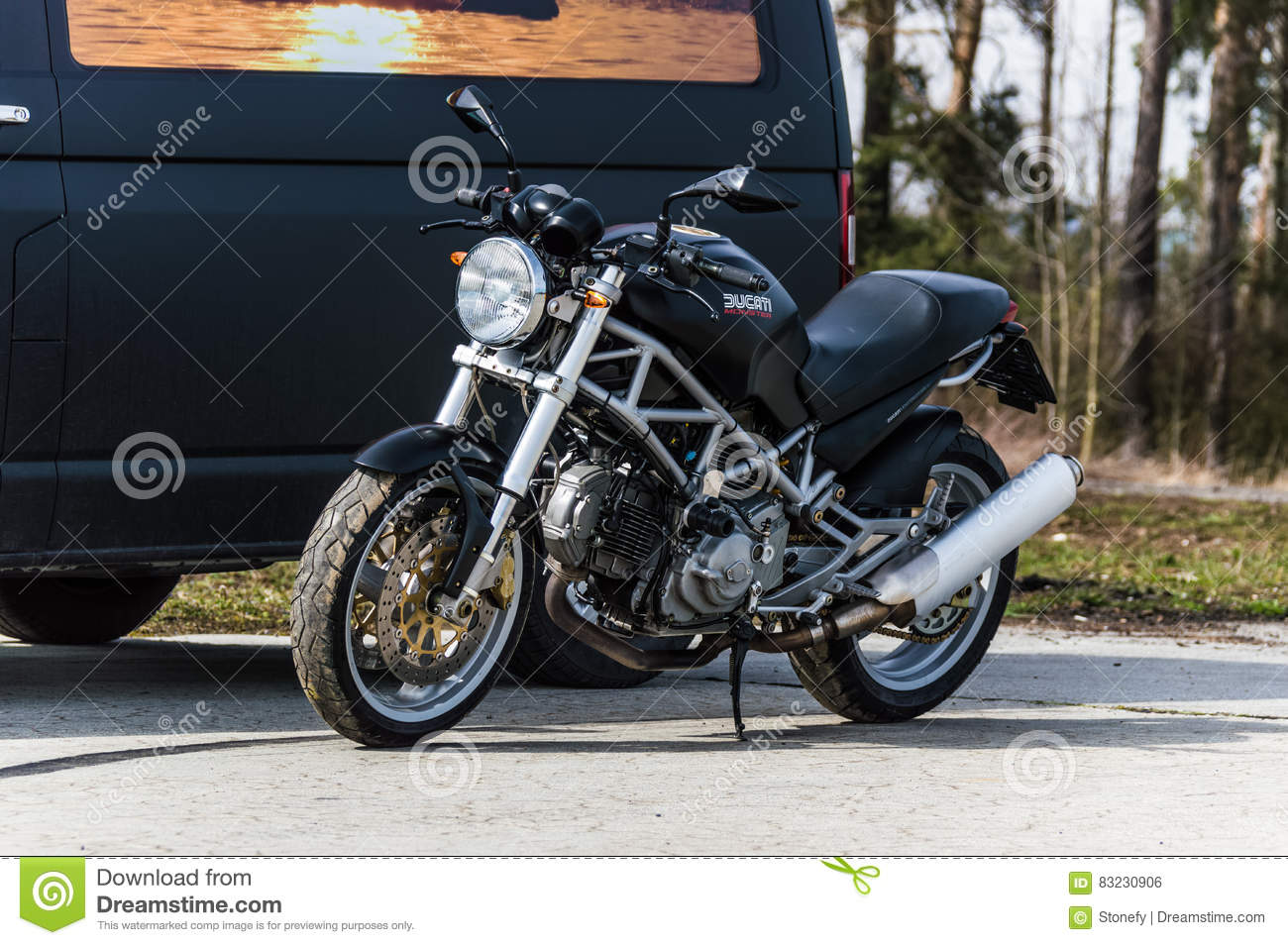 A Black Ducati Bike Standing Beside A Van Editorial Photo Image Of