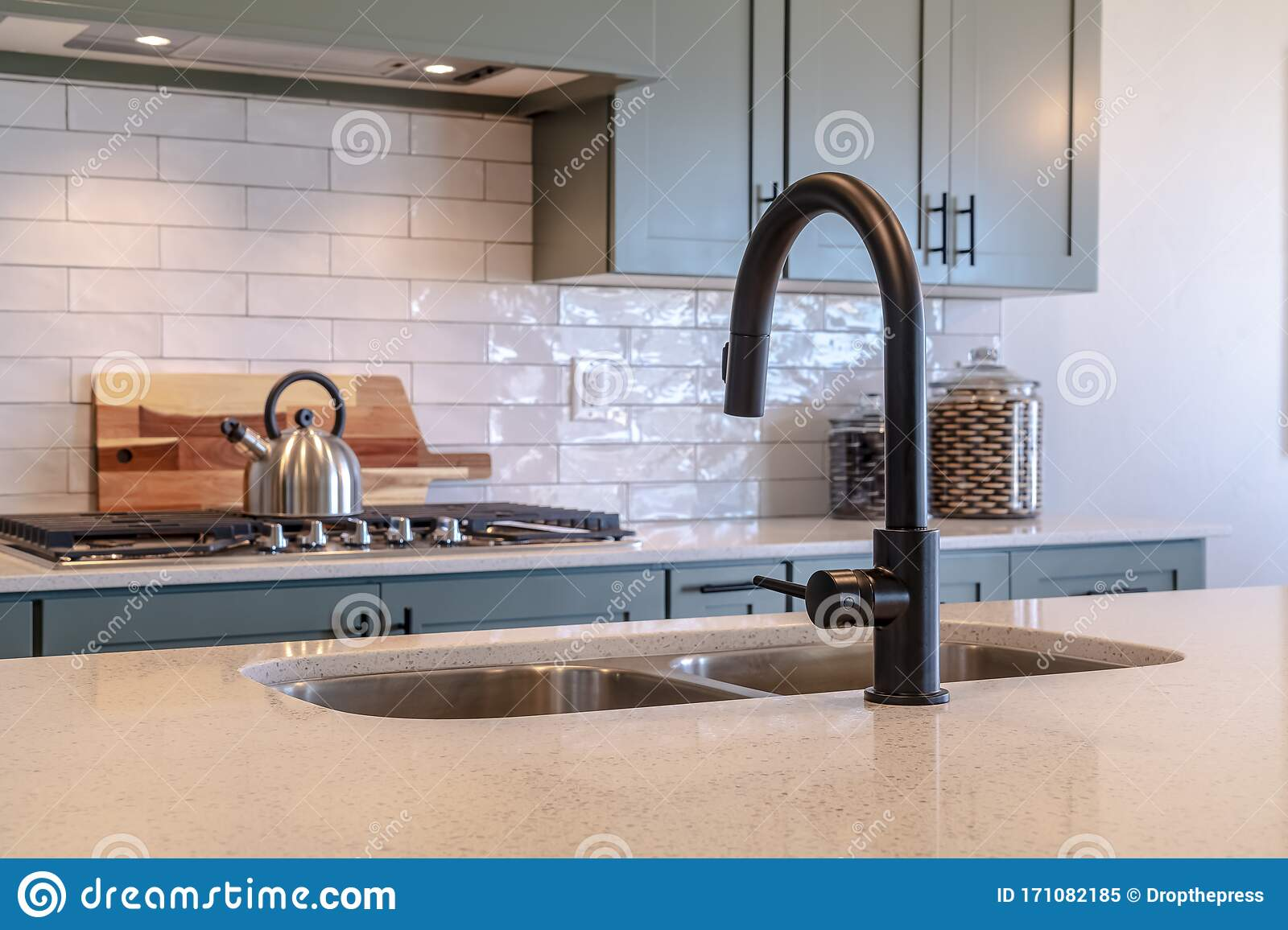 - Black Faucet And Double Bowl Kitchen Island Sink Against Cooktop