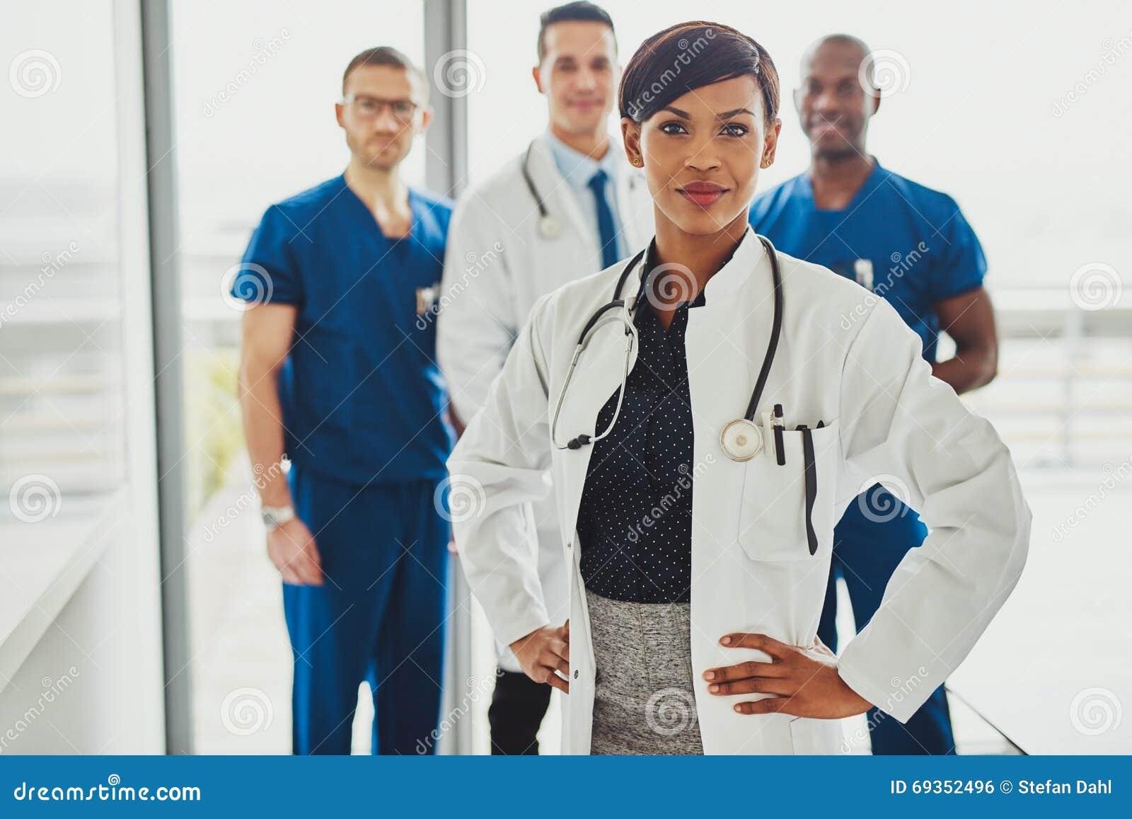 Black female doctor leading medical team