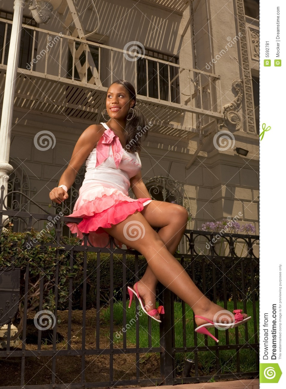 Black fence forged pink sitting skirt woman