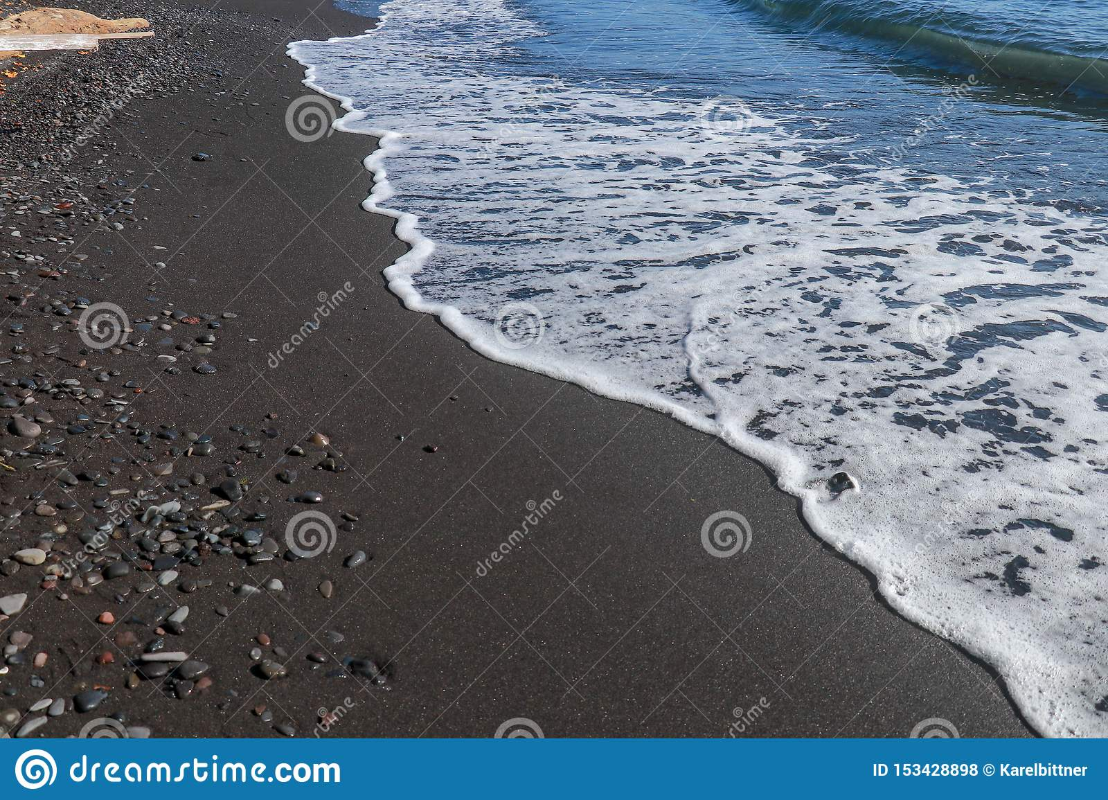 Black Fine Volcanic Sand Beach And Pebbles On Bali Island In Indonesia The Sea Water Reaches The Coast And Turns Into Sea Foam W Stock Photo Image Of Color Seascape 153428898