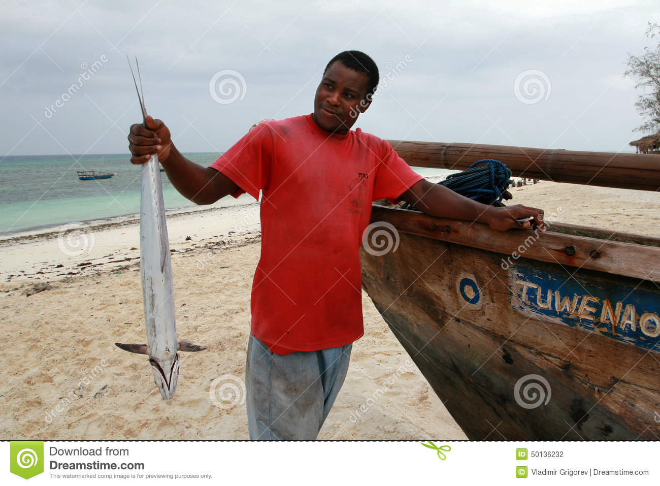 Black Fisherman Holding Kingfish, Zanzibar Editorial ...