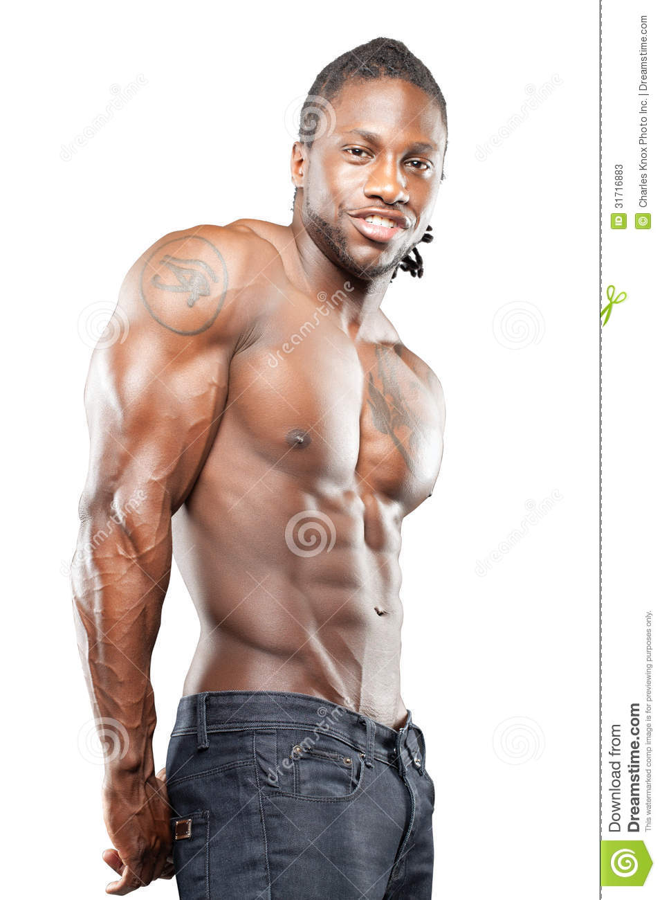 Black fitness model in jeans with no shirt flexing muscles.