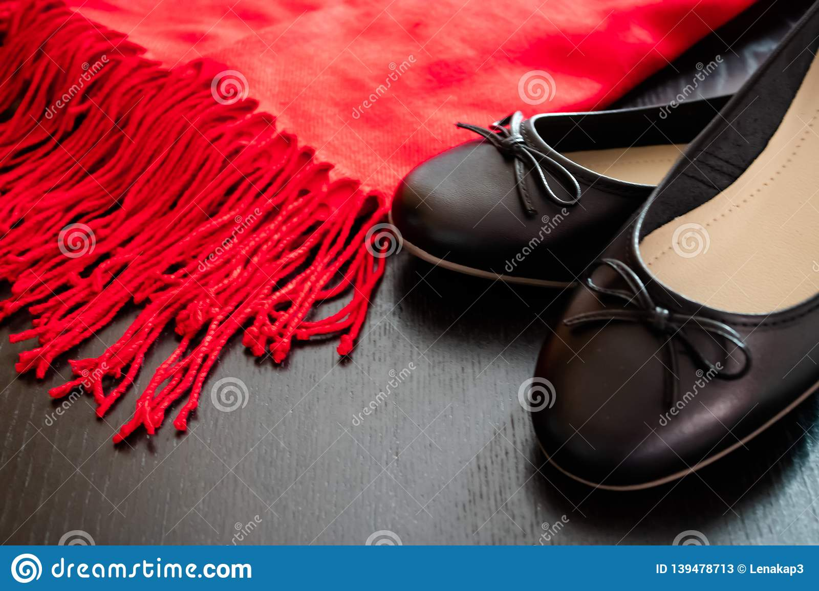 Black flat shoes with the red scarf