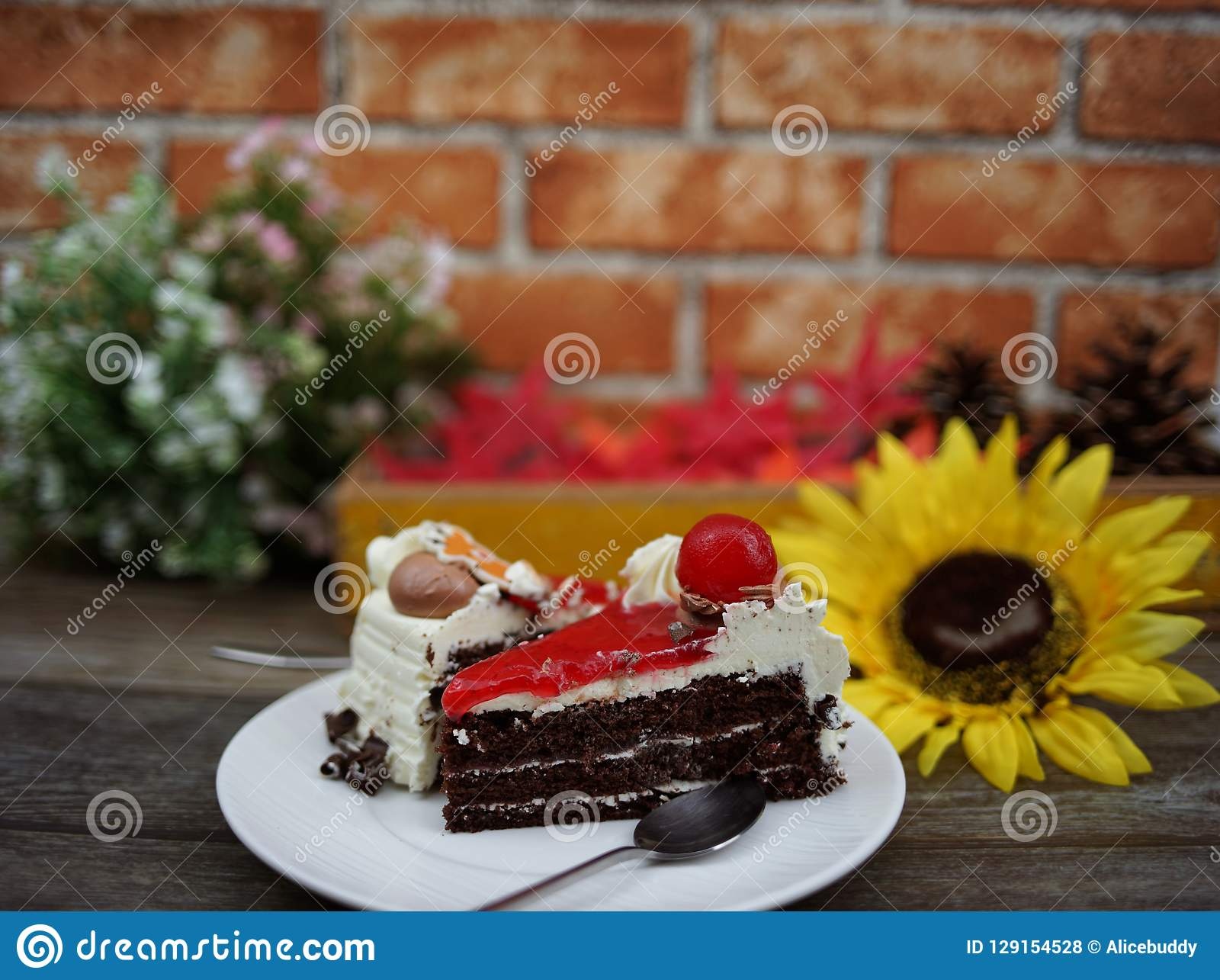 Black forest cake and flower in background