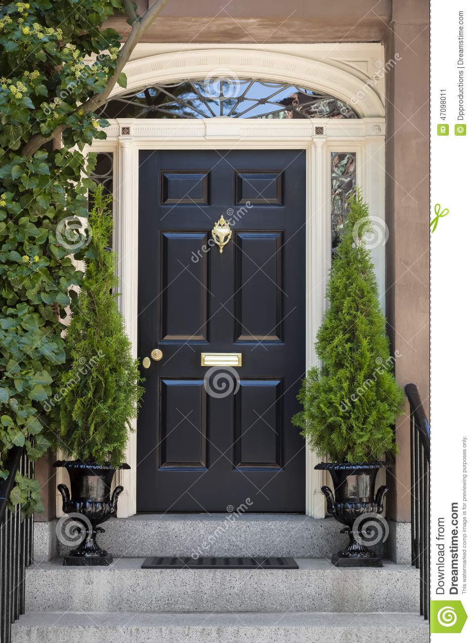 7182bd3ae4d Black Front Door With White Door Frame And Greenery Stock Image ...